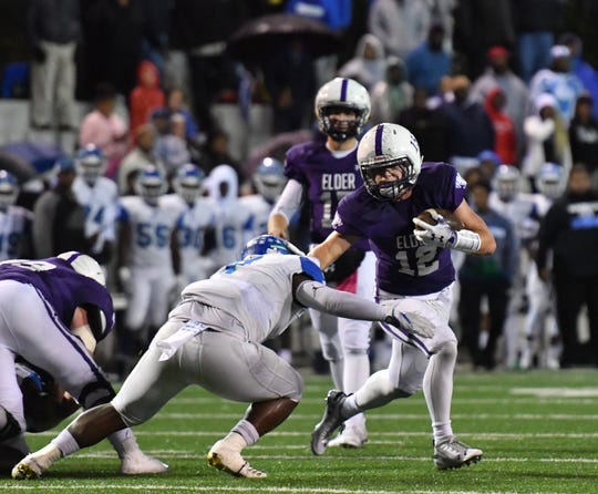 Elder's Jake O'Brien rushes for positive yards against Winton Woods Friday, Oct. 12, 2018.