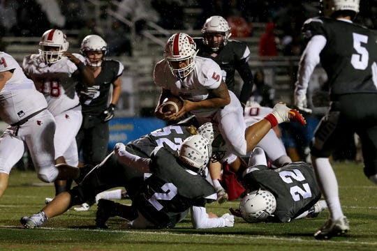 Colerain Cardinals running back Ivan Pace Jr. (5) carries the ball on a touchdown run in the first quarter during a high school football game between the Colerain Cardinals and the Lakota East Thunderhawks, Friday, Oct. 12, 2018, at Lakota East High School in Liberty Township, Ohio.
