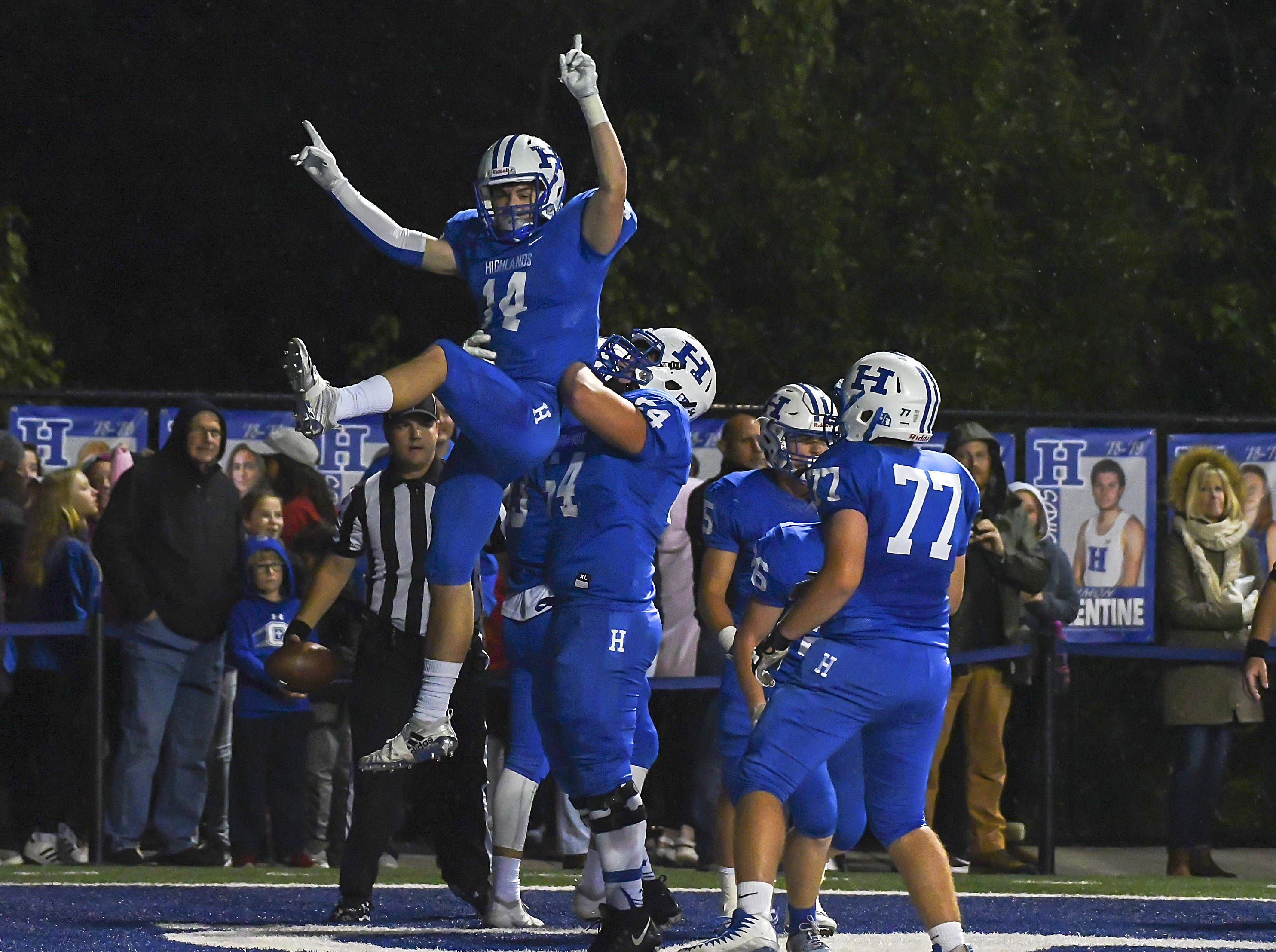 Hunter Ahlfield (14) is lifted by his team after a Bluebird touchdown against Covington Catholic, Highlands High School, Ft. Thomas, KY, Friday, October 12, 2018