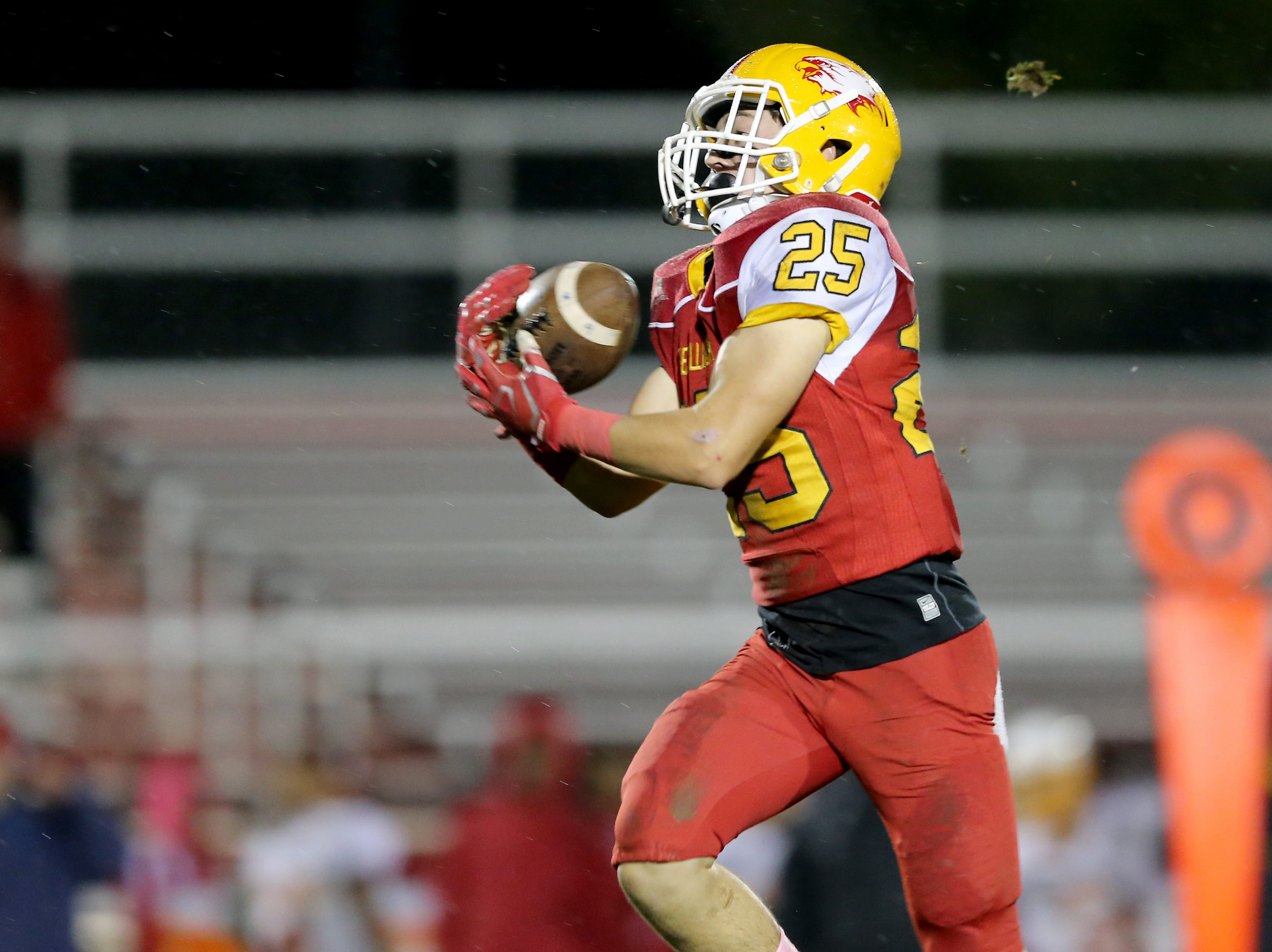Bishop Fenwick wide receiver David Schu (25) catches a pass en route to a touchdown in the third quarter during a high school football game between Purcell Marian and Bishop Fenwick, Friday, Oct. 12, 2018, at Bishop Fenwick High School in Middletown, Ohio.