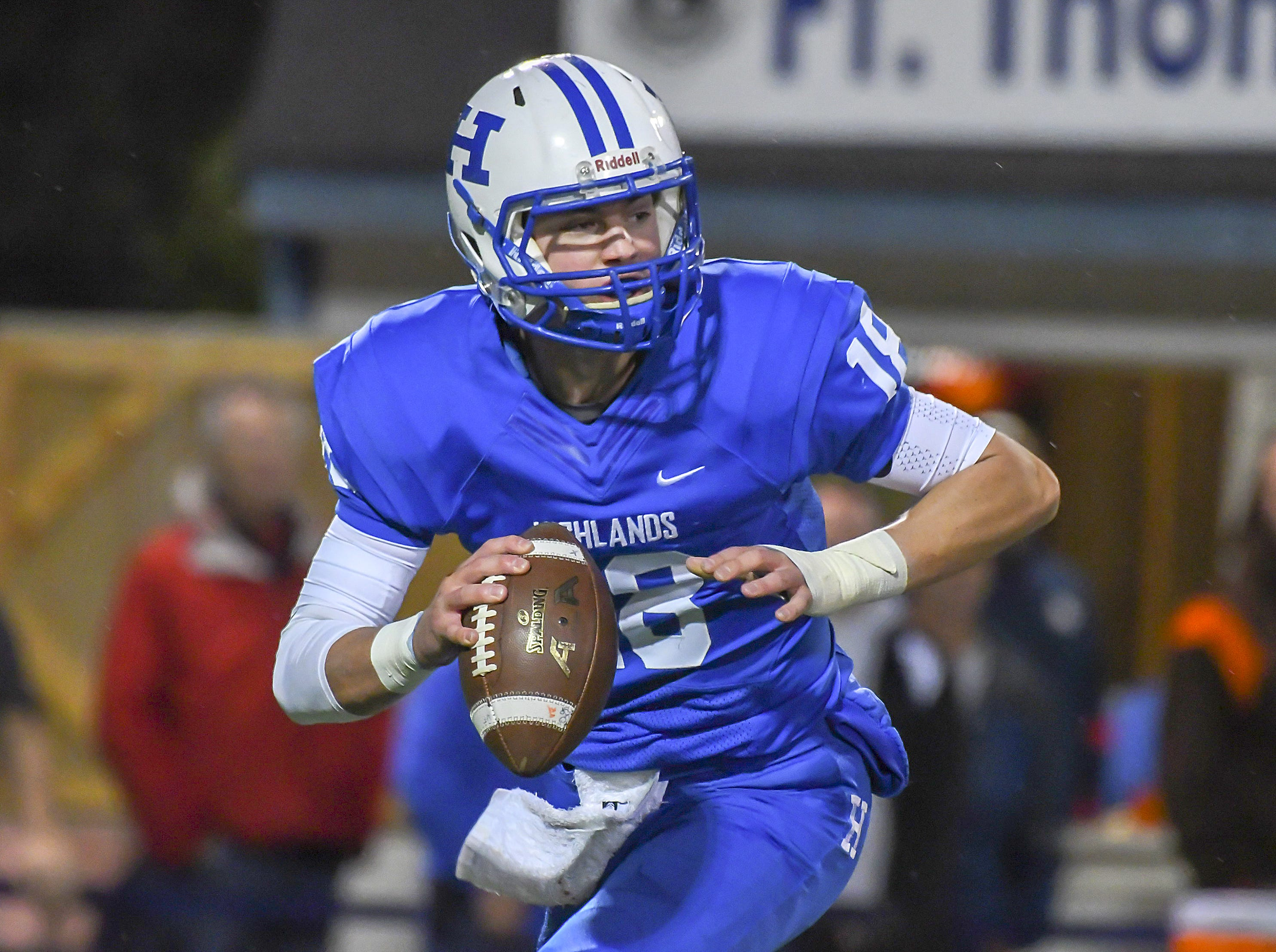 Bluebirds quarterback Grady Cramer runs out of the pocket against Covington Catholic, Highlands High School, Ft. Thomas, KY, Friday, October 12, 2018