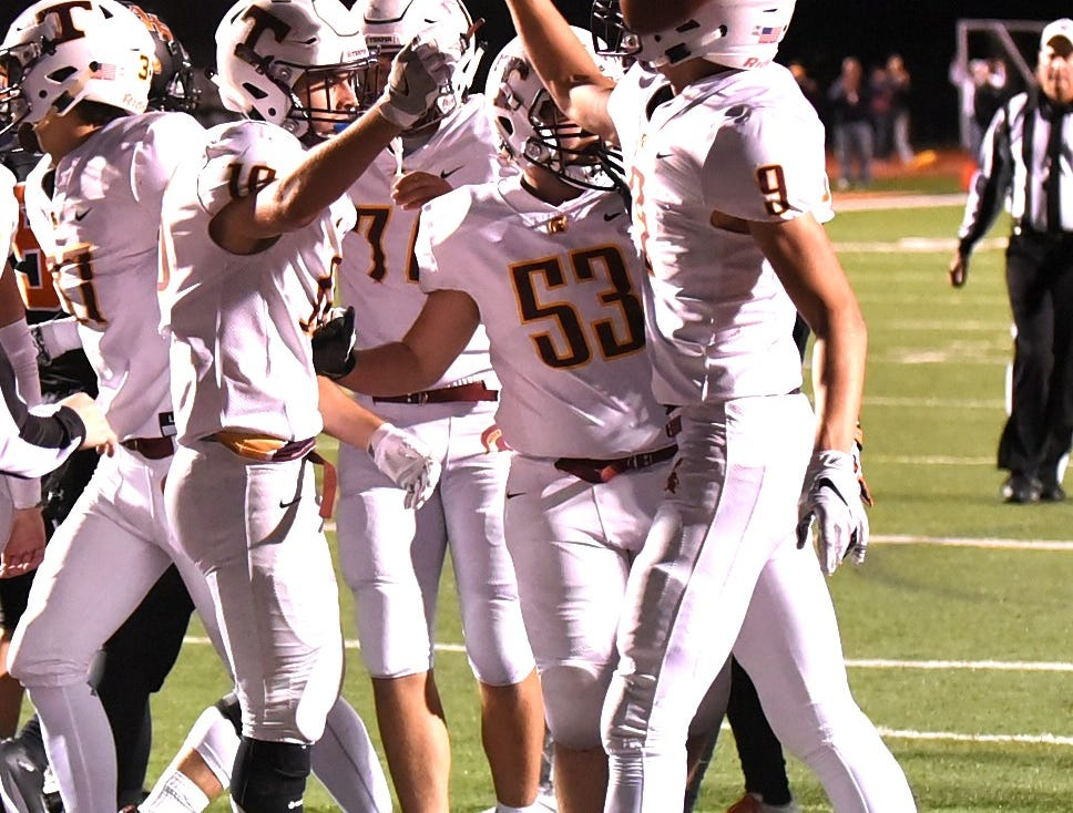 Reece Evans (16) of Turpin executes the ball flip and high five after scoring a Spartans touchdown, October 12, 2018.