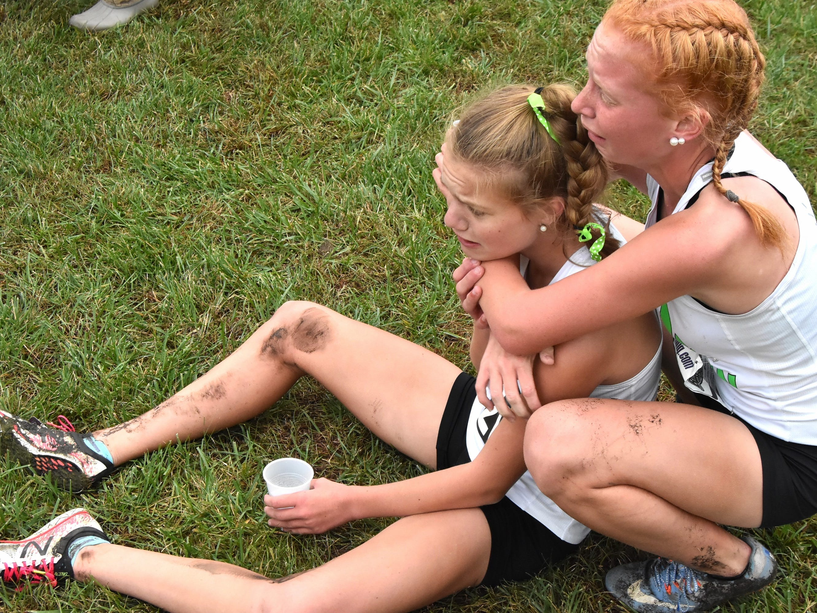 Seton runners share their exhaustion after completing the race at the 2018 GCL/GGCL Cross Country Championships, October 13, 2018.