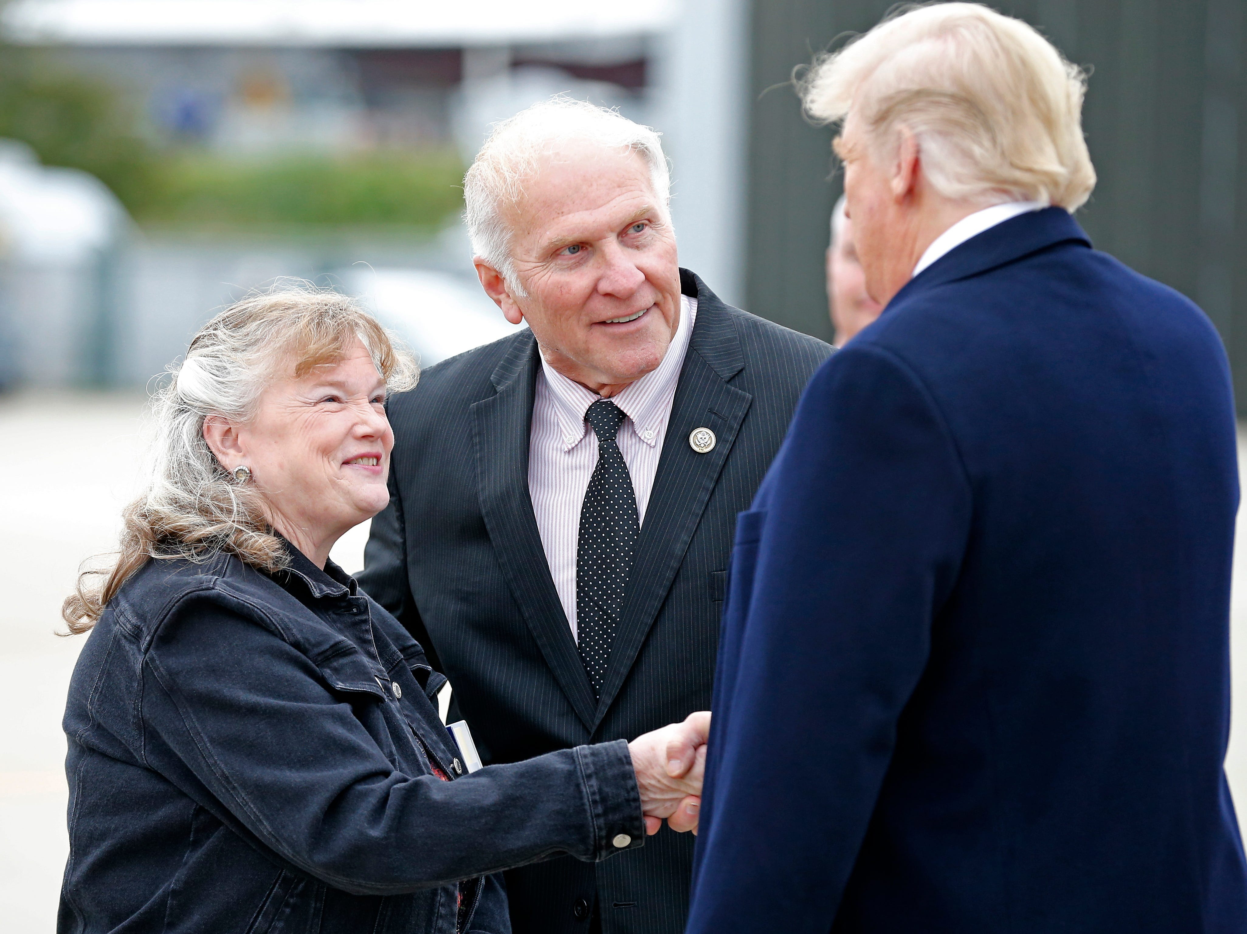 Ohio District 1 Congressman Steve Chabot and his wife Donna shake hands with President Donald Trump after he exits Air Force One at Lunken Airport in Cincinnati on Friday, Oct. 12, 2018. President Trump visited the Cincinnati area for a MAGA Rally at the Warren County Fair Grounds in Lebanon, Ohio, Friday night.