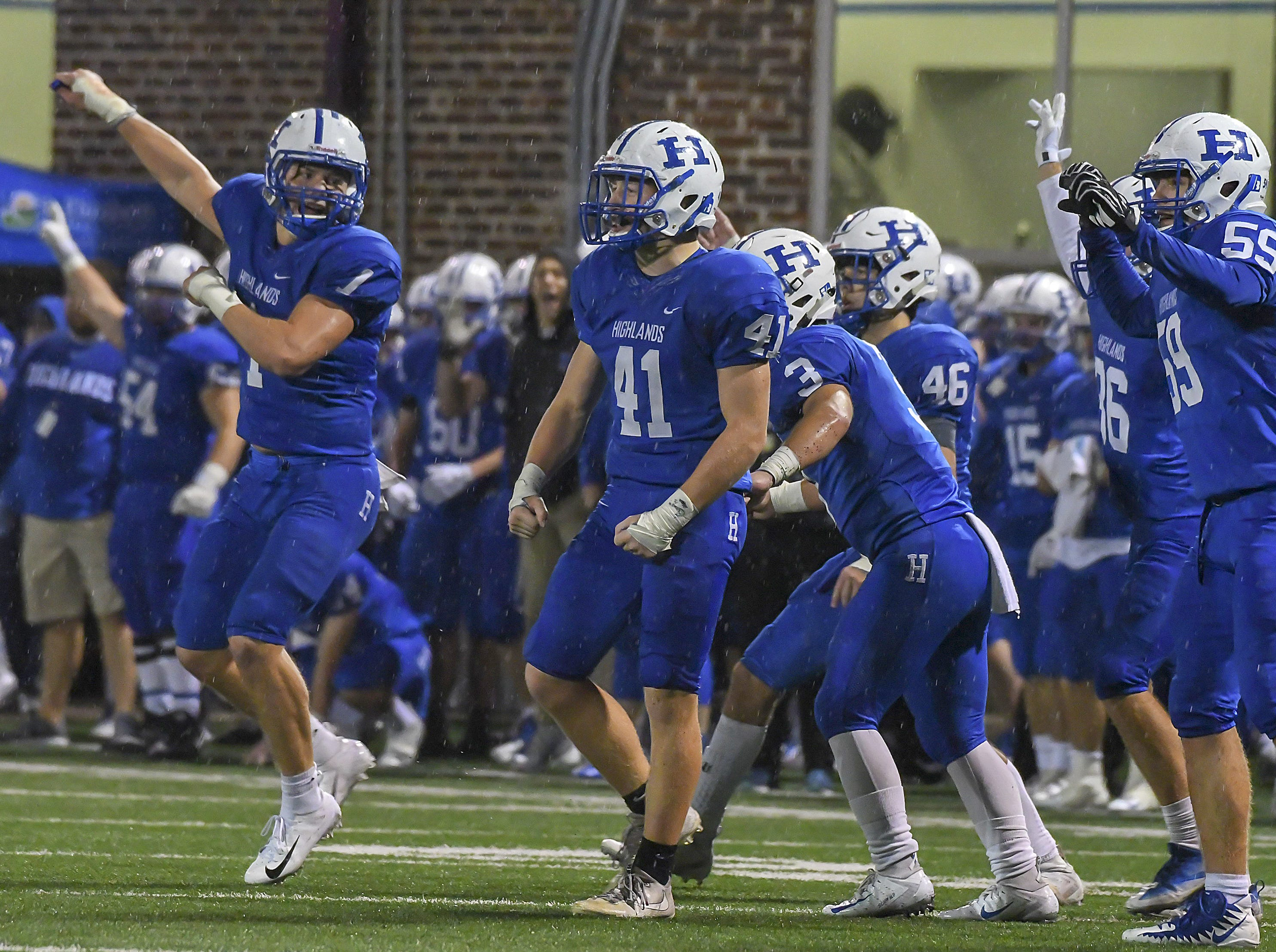 The Highlands Bluebirds celebrate after a stop on fourth down against Covington Catholic, Highlands High School, Ft. Thomas, KY, Friday, October 12, 2018