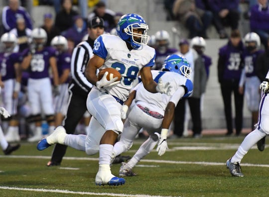 Miyan Williams breaks off a 78-yard run for Winton Woods in the first half against Elder.  Williams fumbled at the 2-yard line and Elder recovered. Friday, Oct. 12, 2018 at High School