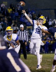 Newport Central Catholic quarterback Paul Kremer throws long against Lloyd Memorial during their game at Cecil Dees Stadium in Erlanger Friday, October 12, 2018.