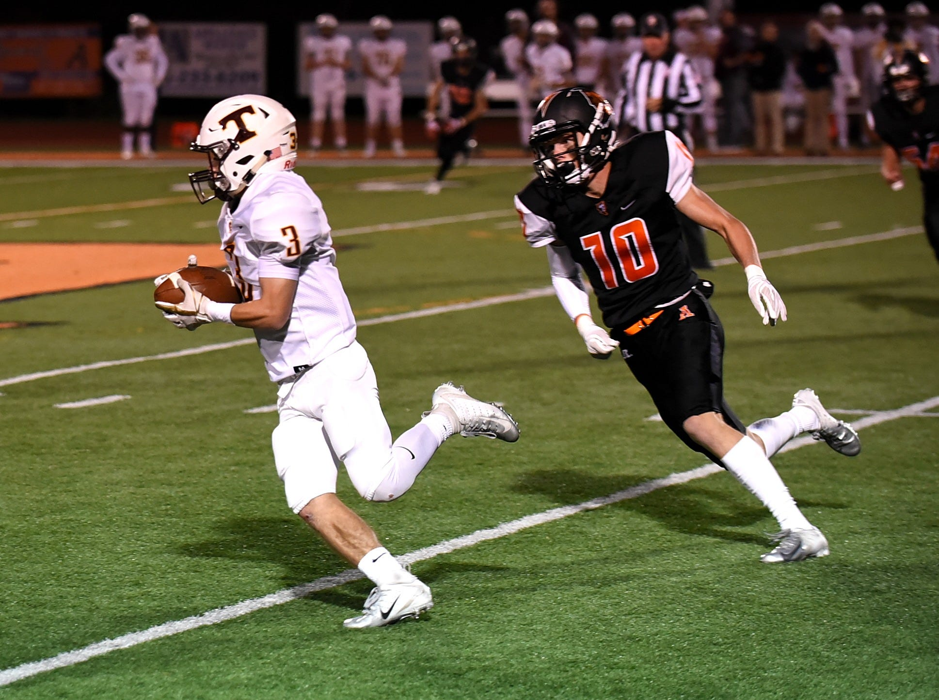 Turpin's Cody Kidd (3) turns the corner past Anderson's Ethan Hamilton (10) for a Spartan's first down, October 12, 2018.