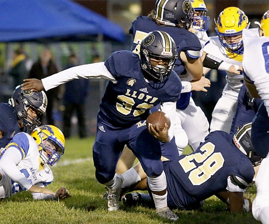 Lloyd Memorial running back Travon Mason carries the ball against Newport Central Catholic during their game at Cecil Dees Stadium in Erlanger Friday, October 12, 2018.