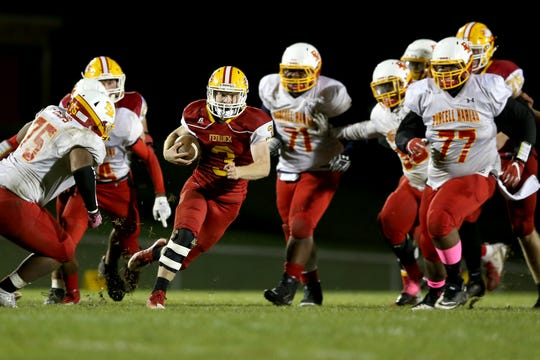 Bishop Fenwick running back Jack Fessler (3) carries the ball on a touchdown run in the third quarter during a high school football game between Purcell Marian and Bishop Fenwick, Friday, Oct. 12, 2018, at Bishop Fenwick High School in Middletown, Ohio.