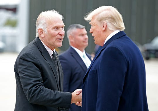 Ohio District 1 Congressman Steve Chabot shakes hands with President Donald Trump after he exits Air Force One at Lunken Airport in Cincinnati on Friday, Oct. 12, 2018. President Trump visited the Cincinnati area for a MAGA Rally at the Warren County Fair Grounds in Lebanon, Ohio, Friday night.