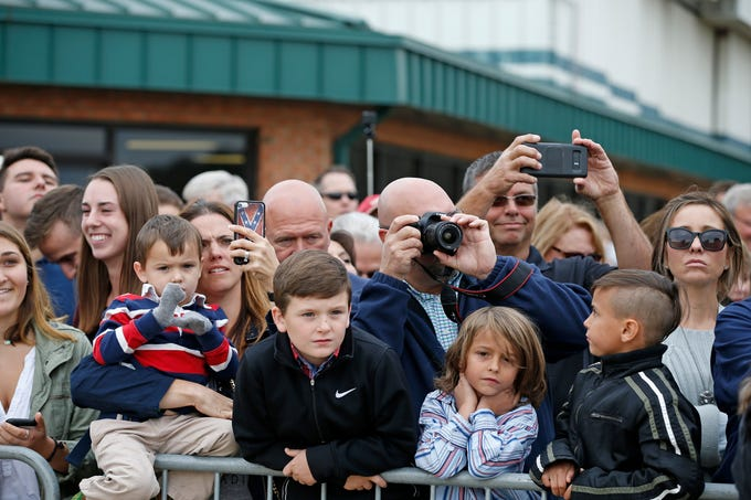 Supporters gather for photos as Air Force One lands at Lunken Airport in Cincinnati on Friday, Oct. 12, 2018. President Trump visited the Cincinnati area for a MAGA Rally at the Warren County Fair Grounds in Lebanon, Ohio, Friday night.