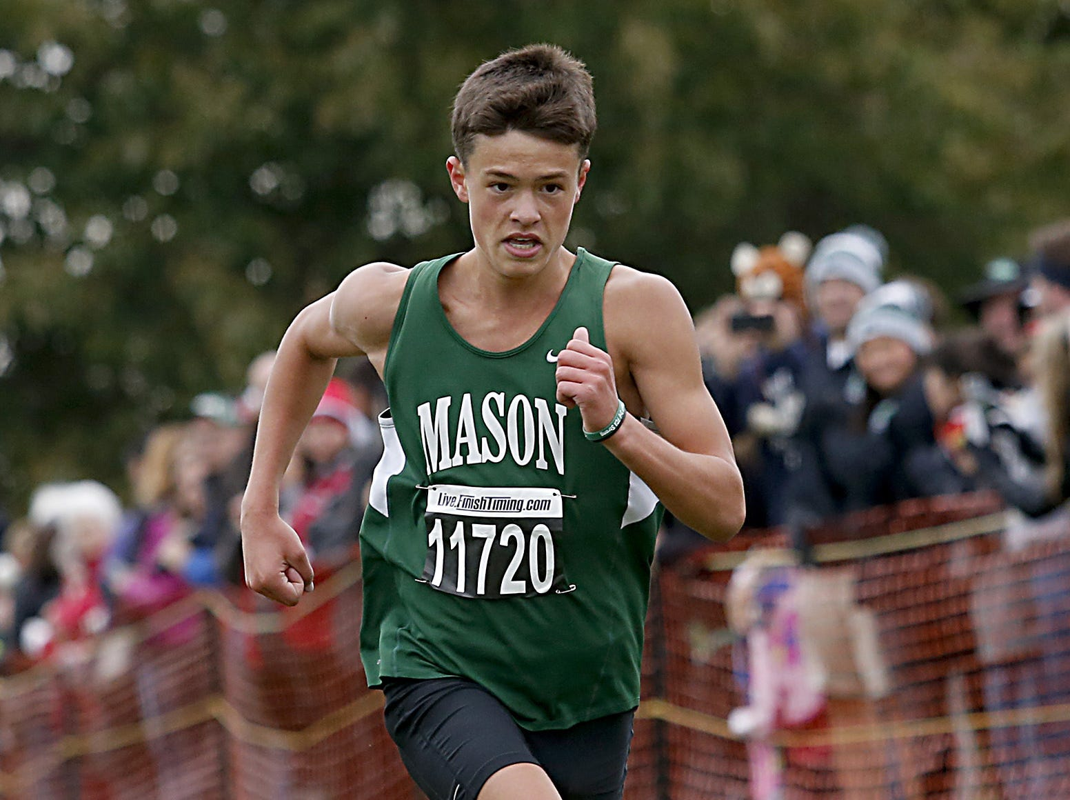 Mason's Isaiah Kelly crosses the finish line in second place during the Greater Miami Conference Girls and Boys Cross Country Championships at Voice of America Park in West Chester Saturday, Oct. 13, 2018.