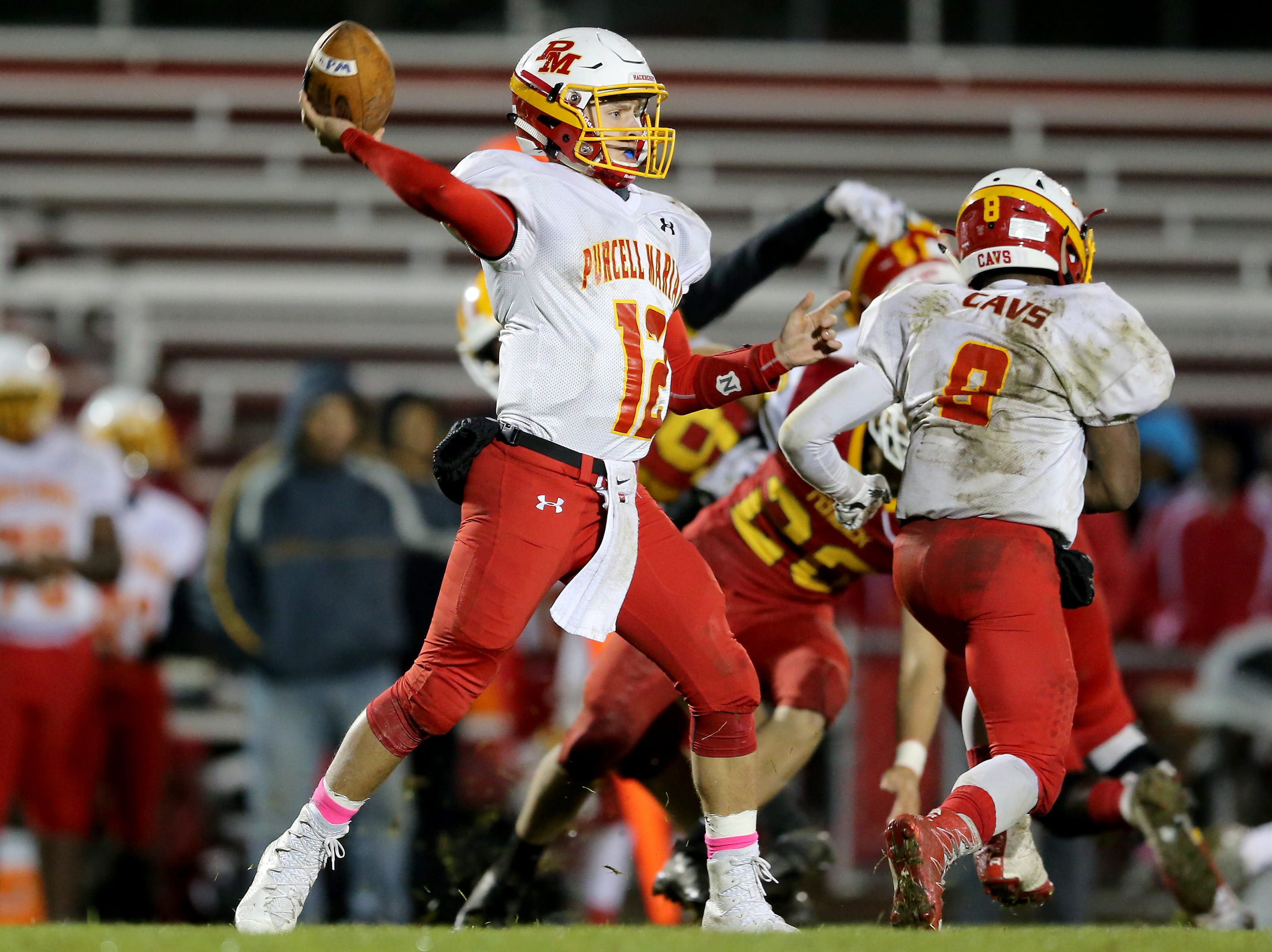Purcell Marian quarterback Zach Hoover (12) throws in the third quarter during a high school football game between Purcell Marian and Bishop Fenwick, Friday, Oct. 12, 2018, at Bishop Fenwick High School in Middletown, Ohio.
