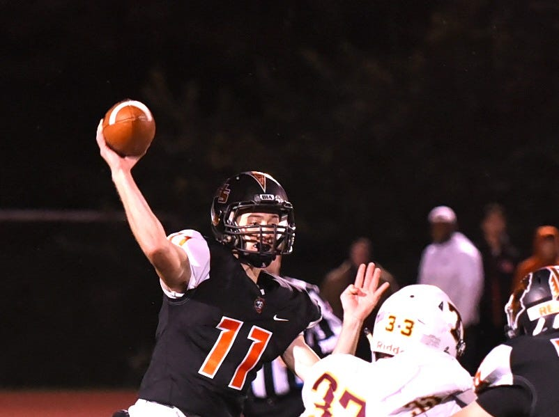 Anderson Quarterback David Thompson eyes a completed pass over the incoming Turpin defense, October 12, 2018.