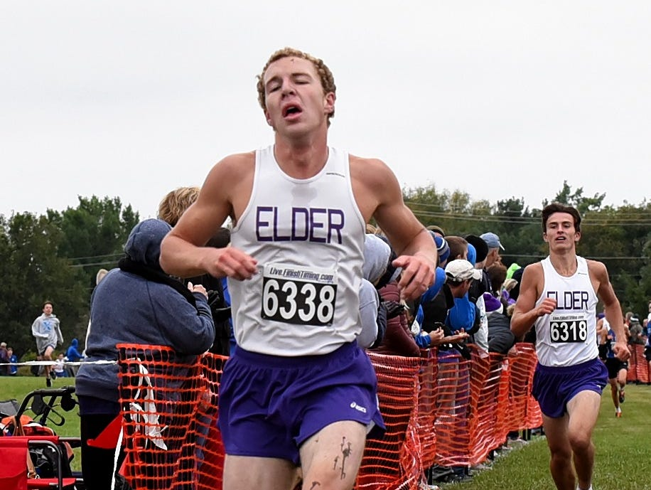 A muddied Jarod Timmers of Elder finishes second at the 2018 GCL/GGCL Cross Country Championships, October 13, 2018.