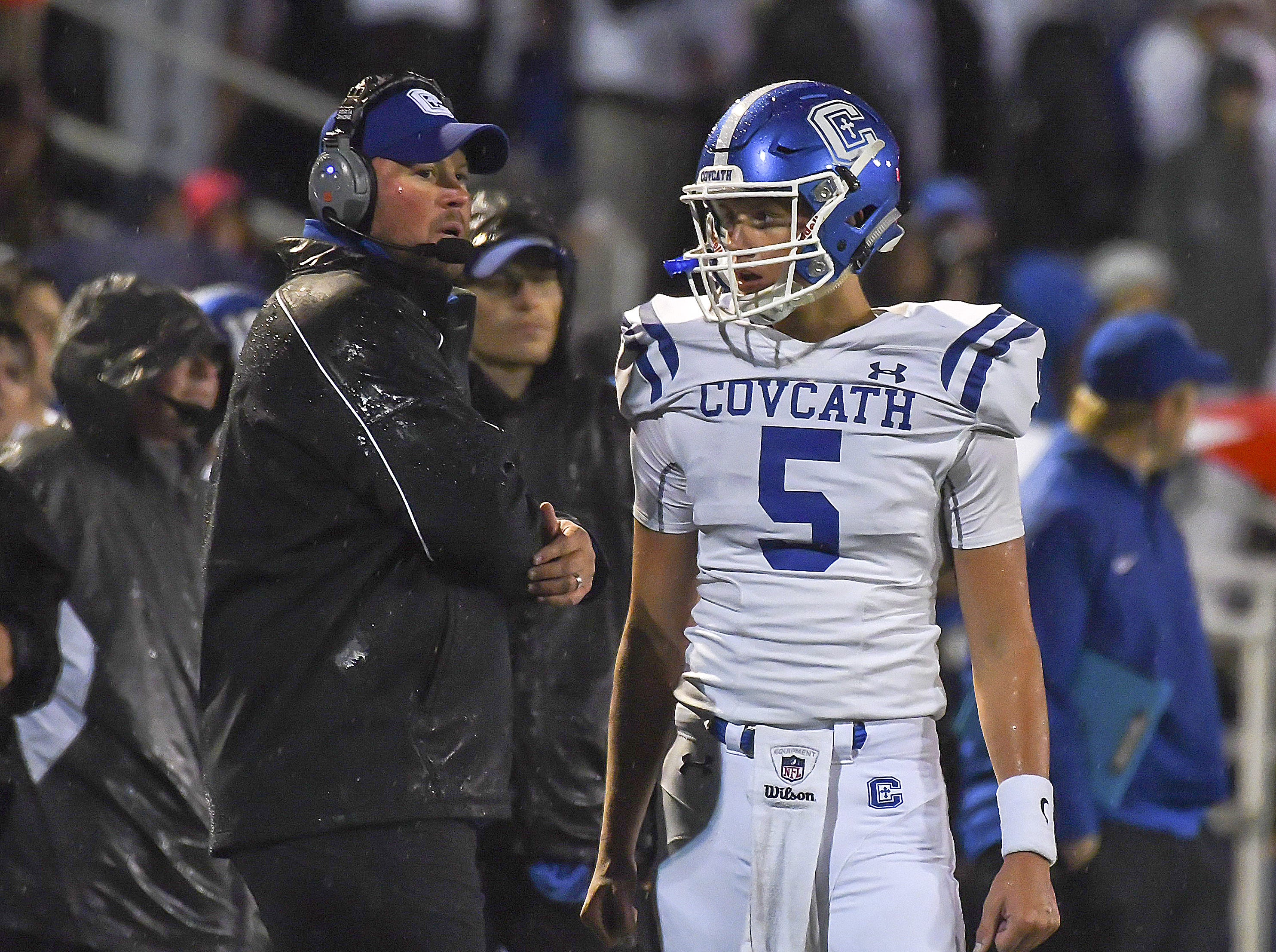 Head coach Eddie Eviston and Caleb Jacob of Covington Catholic talk during a timeout, Highlands High School, Ft. Thomas, KY, Friday, October 12, 2018