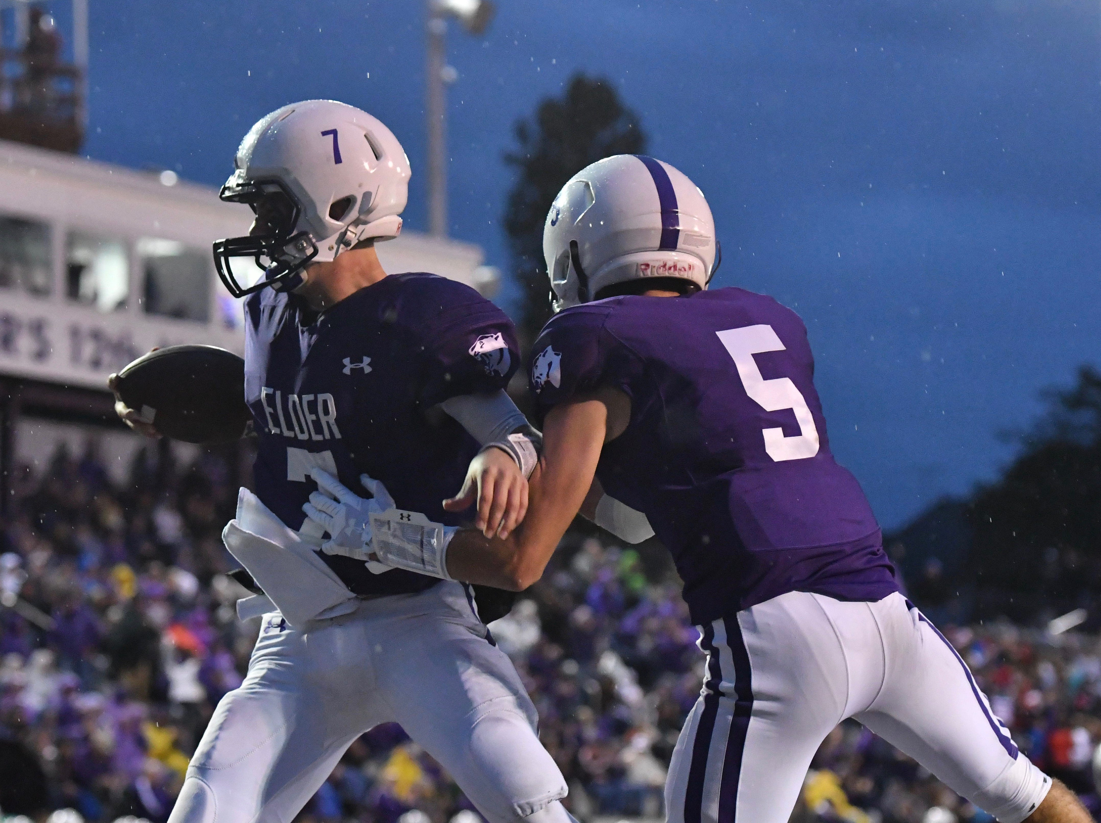 Matthew Luebbe and Sean O'Conner celebrate an Elder Panther touchdown Friday, Oct. 12, 2018 at High School