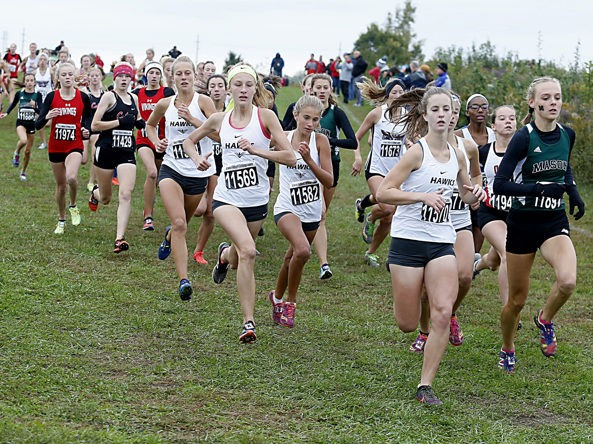 The Lakota East girls run together at the start of the Greater Miami Conference Girls and Boys Cross Country Championships at Voice of America Park in West Chester Saturday, Oct. 13, 2018. The Lakota East girls finished first in team points.