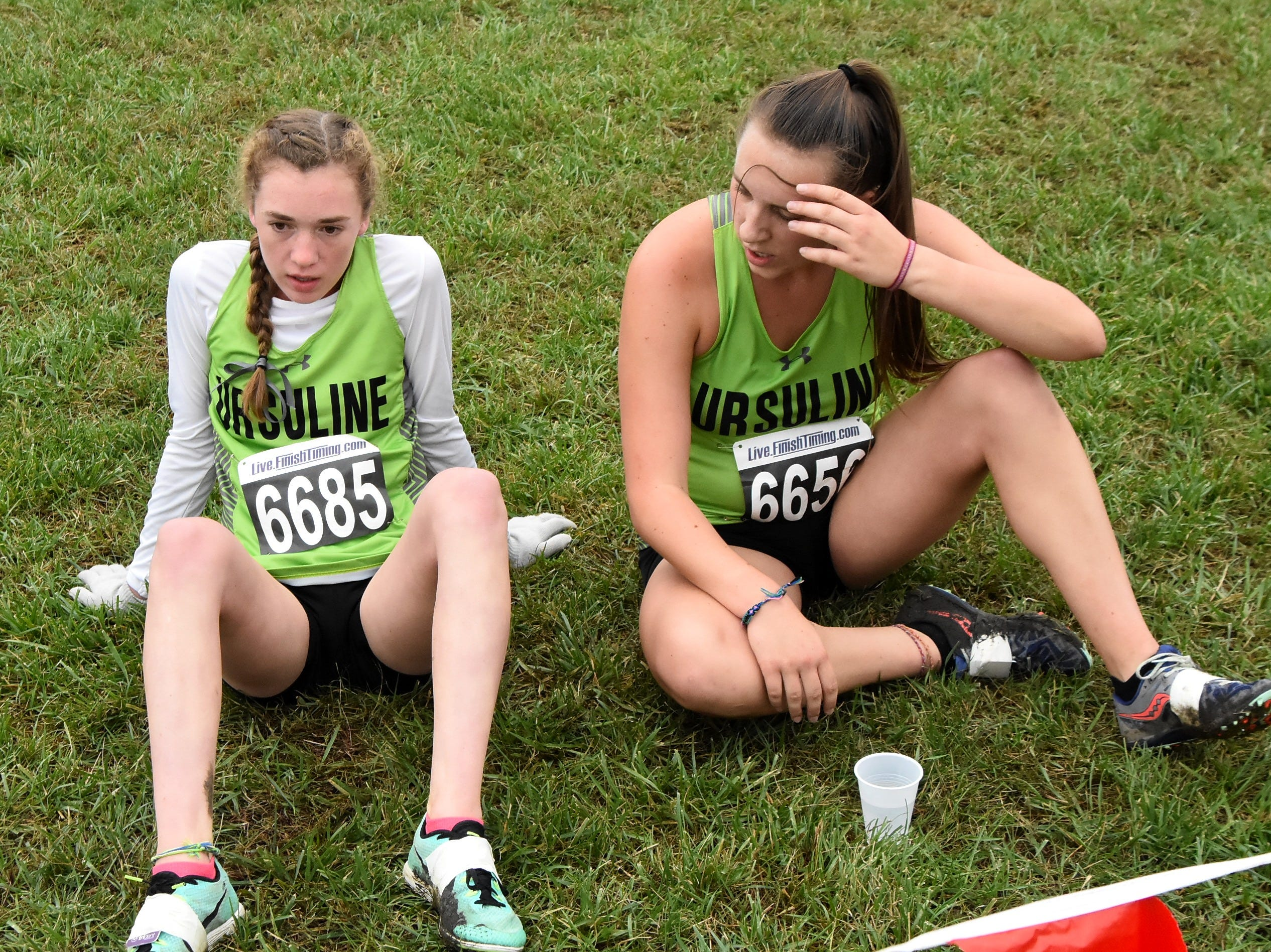 Ursuline's Sophie Taylor and Mia Czarnecki rest at the finish area after running strong at the 2018 GCL/GGCL Cross Country Championships, October 13, 2018.