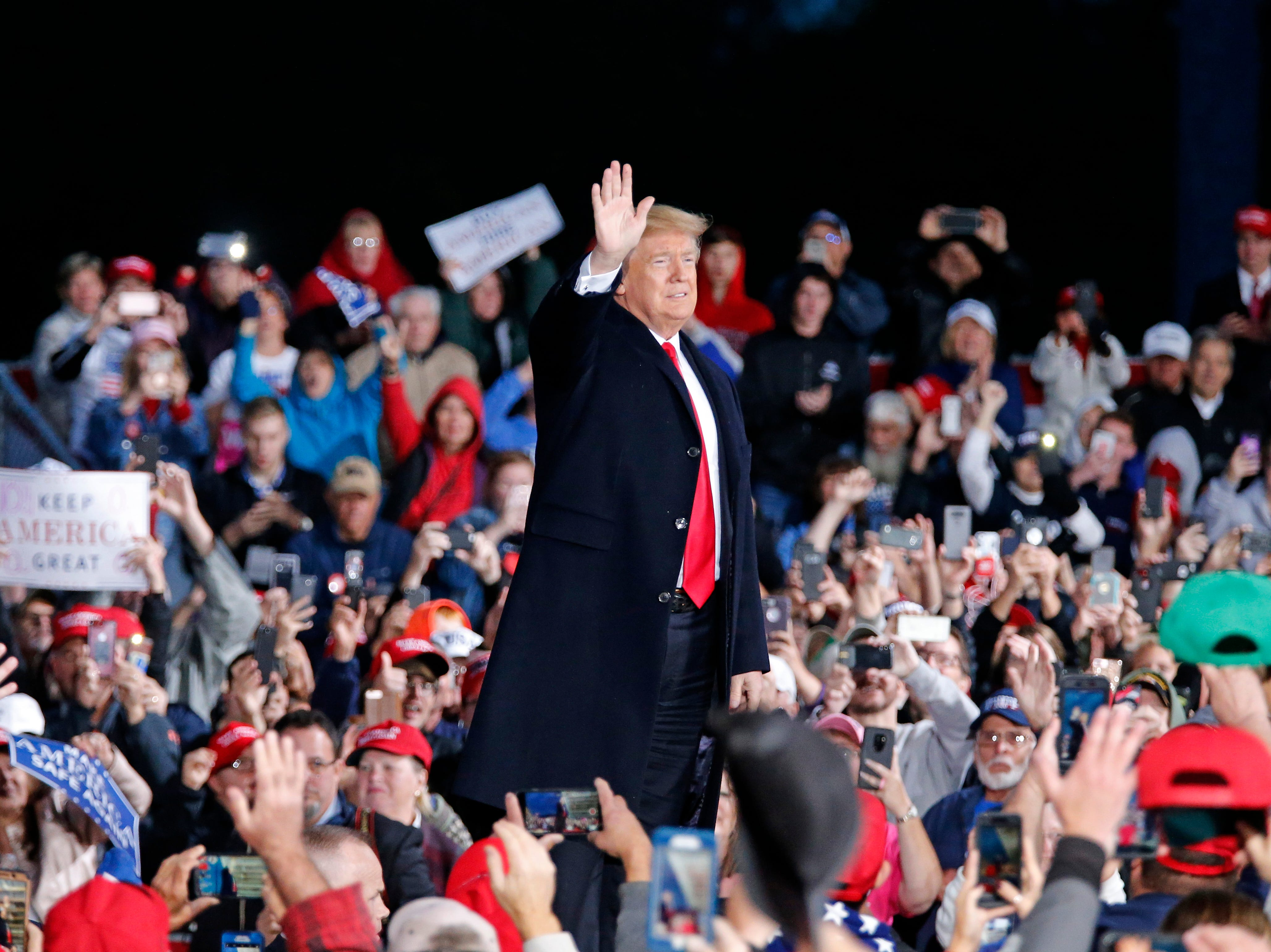 President Donald Trump takes the state as he's introduced during a Make America Great Again rally at the warren County Fair Grounds in Lebanon, Ohio, on Friday, Oct. 12, 2018.