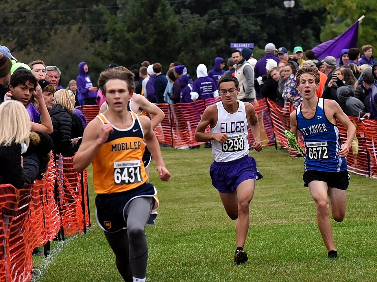 Moeller's Nicholas Eiben, Elder's Jacob Cowans and William Harmeyer of St. Xavier head down the homestretch at the 2018 GCL/GGCL Cross Country Championships, October 13, 2018.