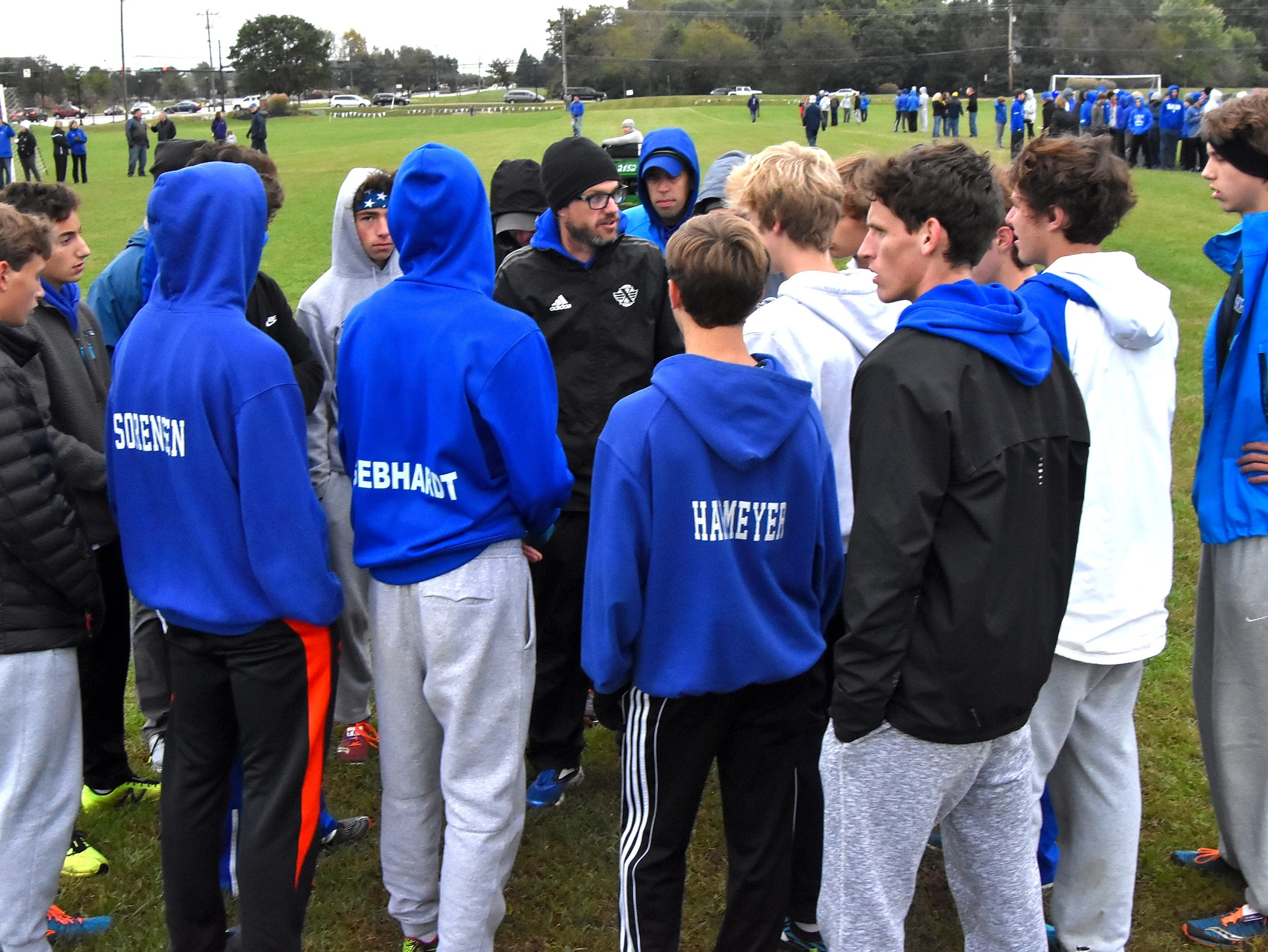 St. Xavier runners get a final team talk before running at the 2018 GCL/GGCL Cross Country Championships, October 13, 2018.