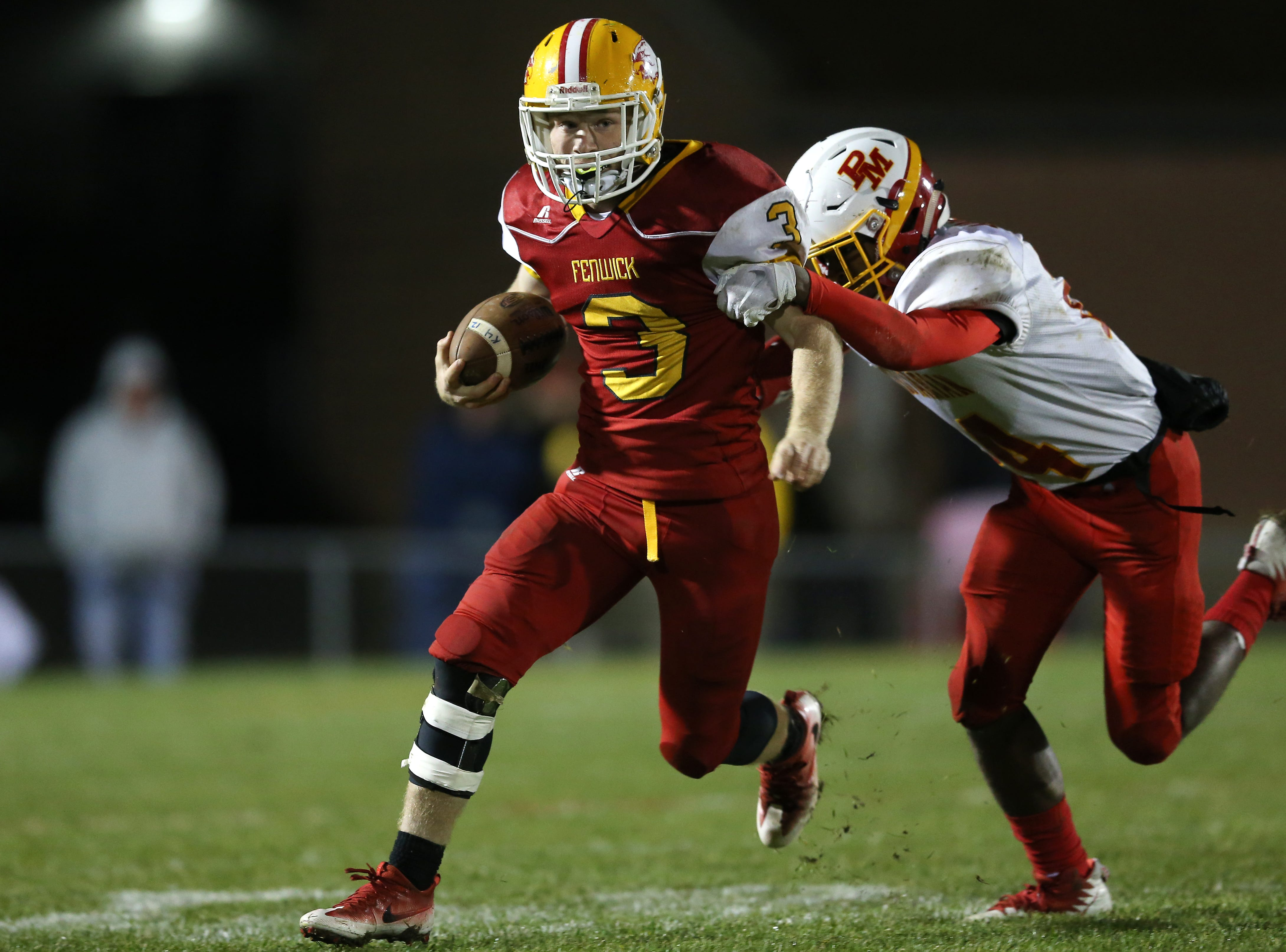 Bishop Fenwick running back Jack Fessler (3) carries the ball in the fourth quarter during a high school football game between Purcell Marian and Bishop Fenwick, Friday, Oct. 12, 2018, at Bishop Fenwick High School in Middletown, Ohio.