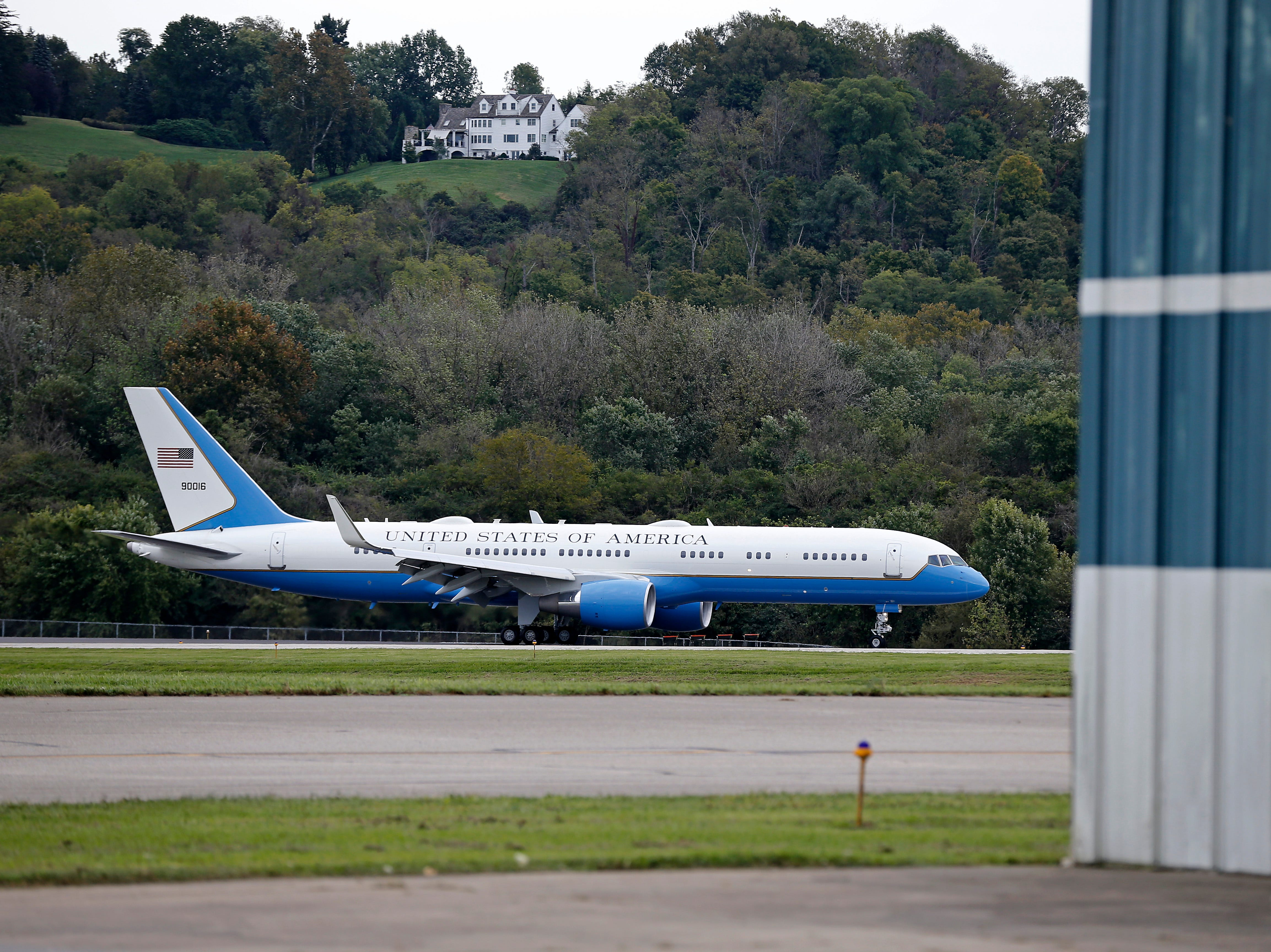 Air Force One taxis after landing at Lunken Airport in Cincinnati on Friday, Oct. 12, 2018. President Trump visited the Cincinnati area for a MAGA Rally at the Warren County Fair Grounds in Lebanon, Ohio, Friday night.