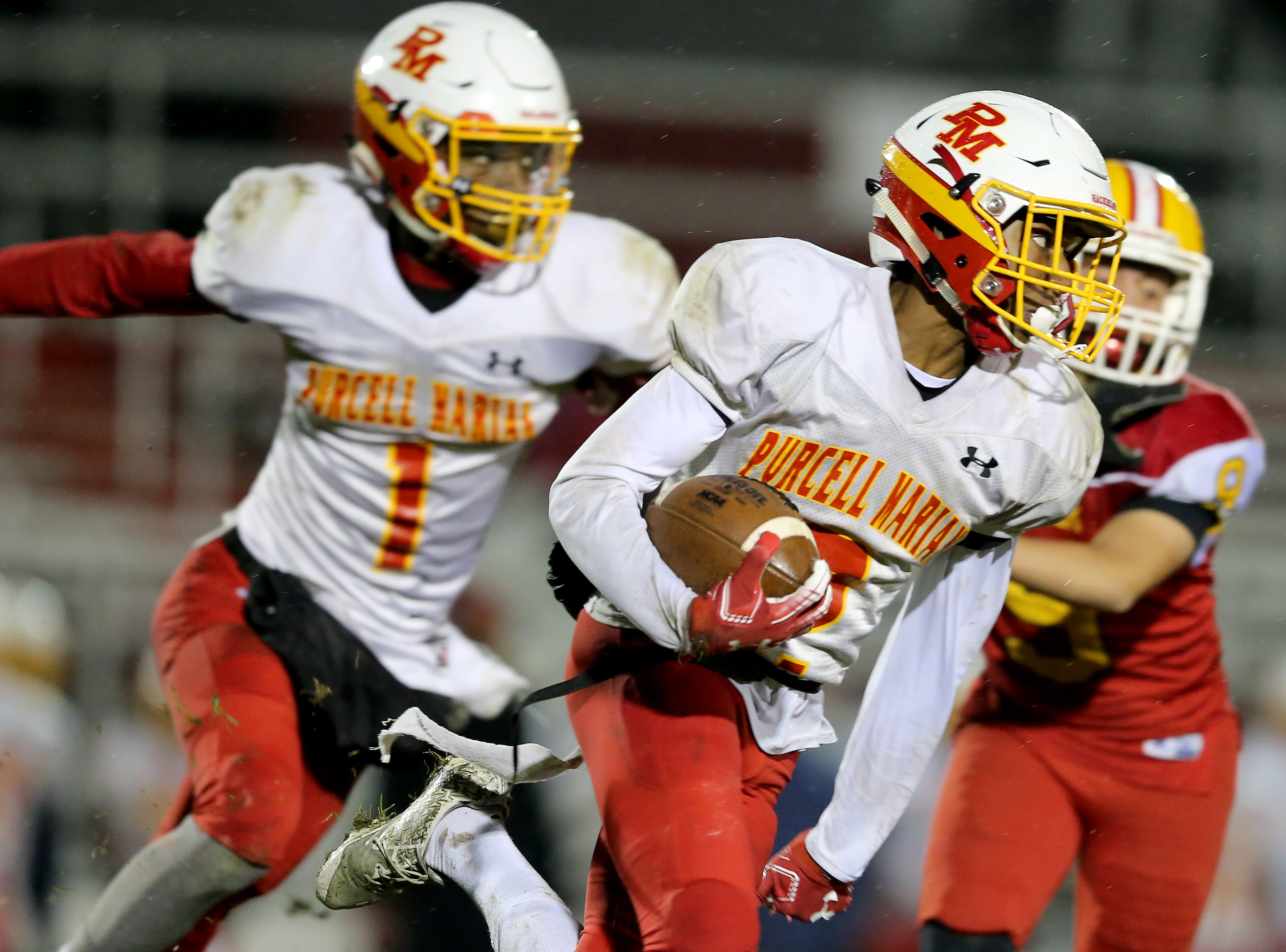 Purcell Marian wide receiver Laurence Christian (2) returns a kickoff in the third quarter during a high school football game between Purcell Marian and Bishop Fenwick, Friday, Oct. 12, 2018, at Bishop Fenwick High School in Middletown, Ohio.