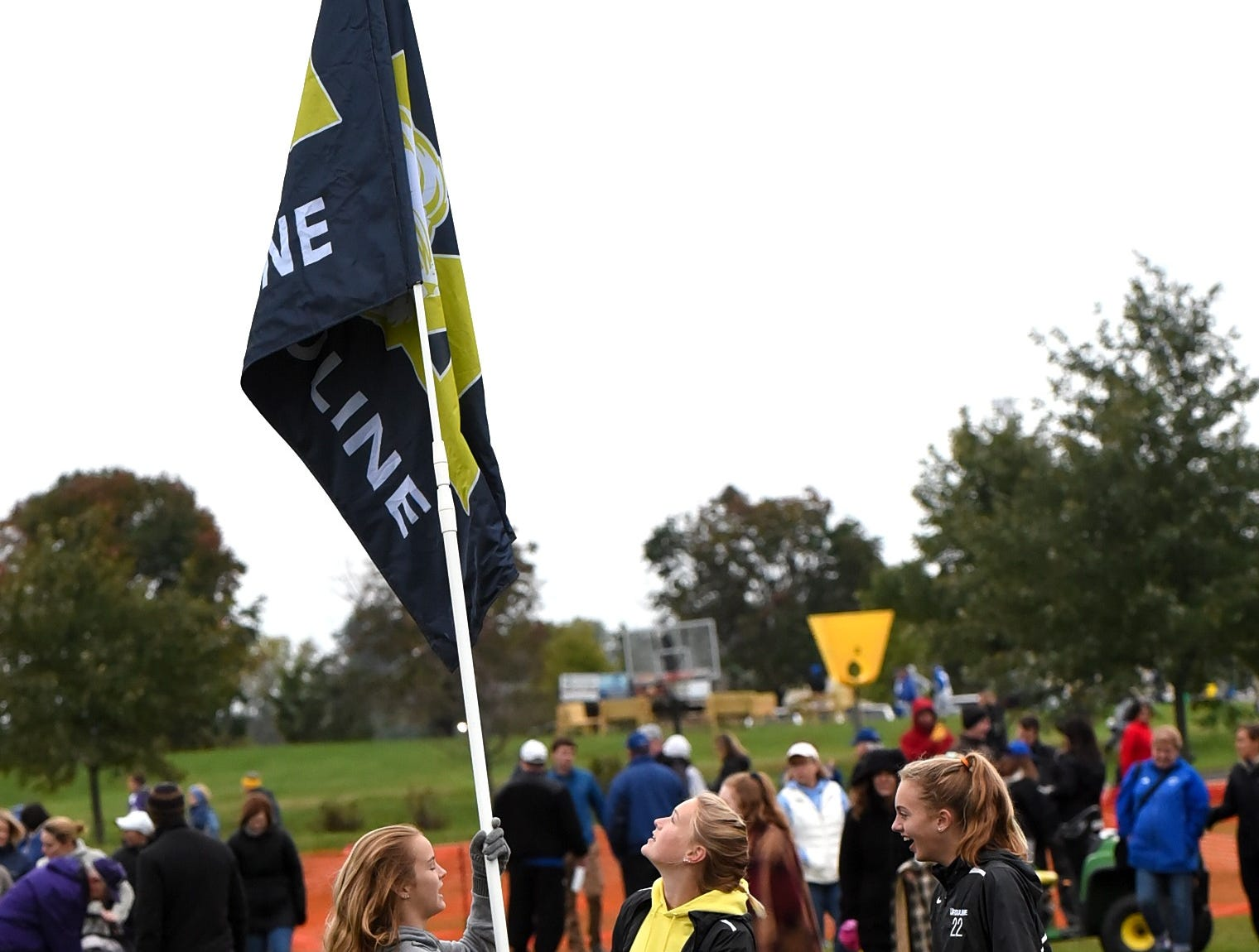 Ursuline Academy students raise the fans flag at the 2018 GCL/GGCL Cross Country Championships, October 13, 2018.