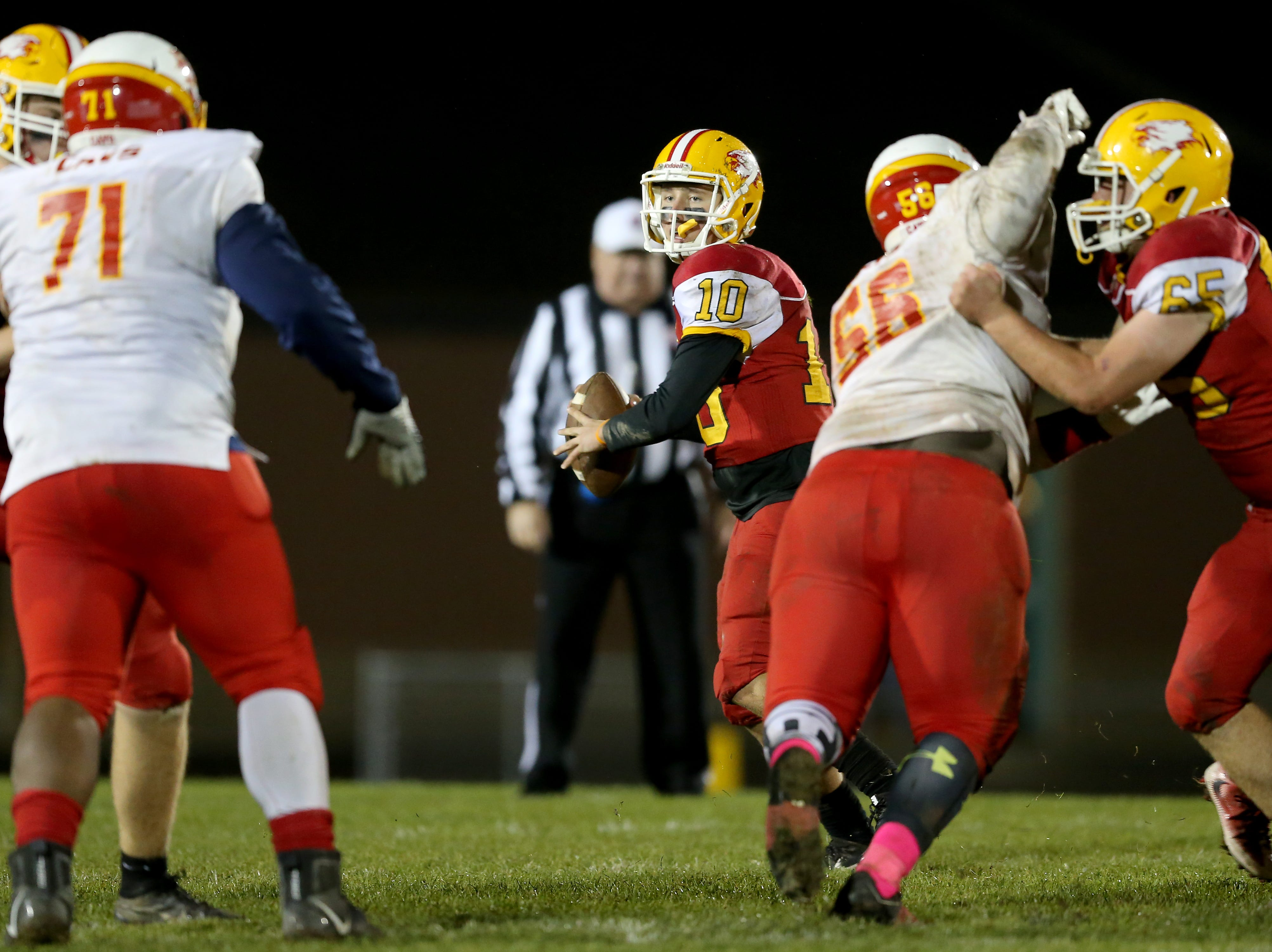Bishop Fenwick quarterback Sully Janeck (10) drops back to pass in the fourth quarter during a high school football game between Purcell Marian and Bishop Fenwick, Friday, Oct. 12, 2018, at Bishop Fenwick High School in Middletown, Ohio.