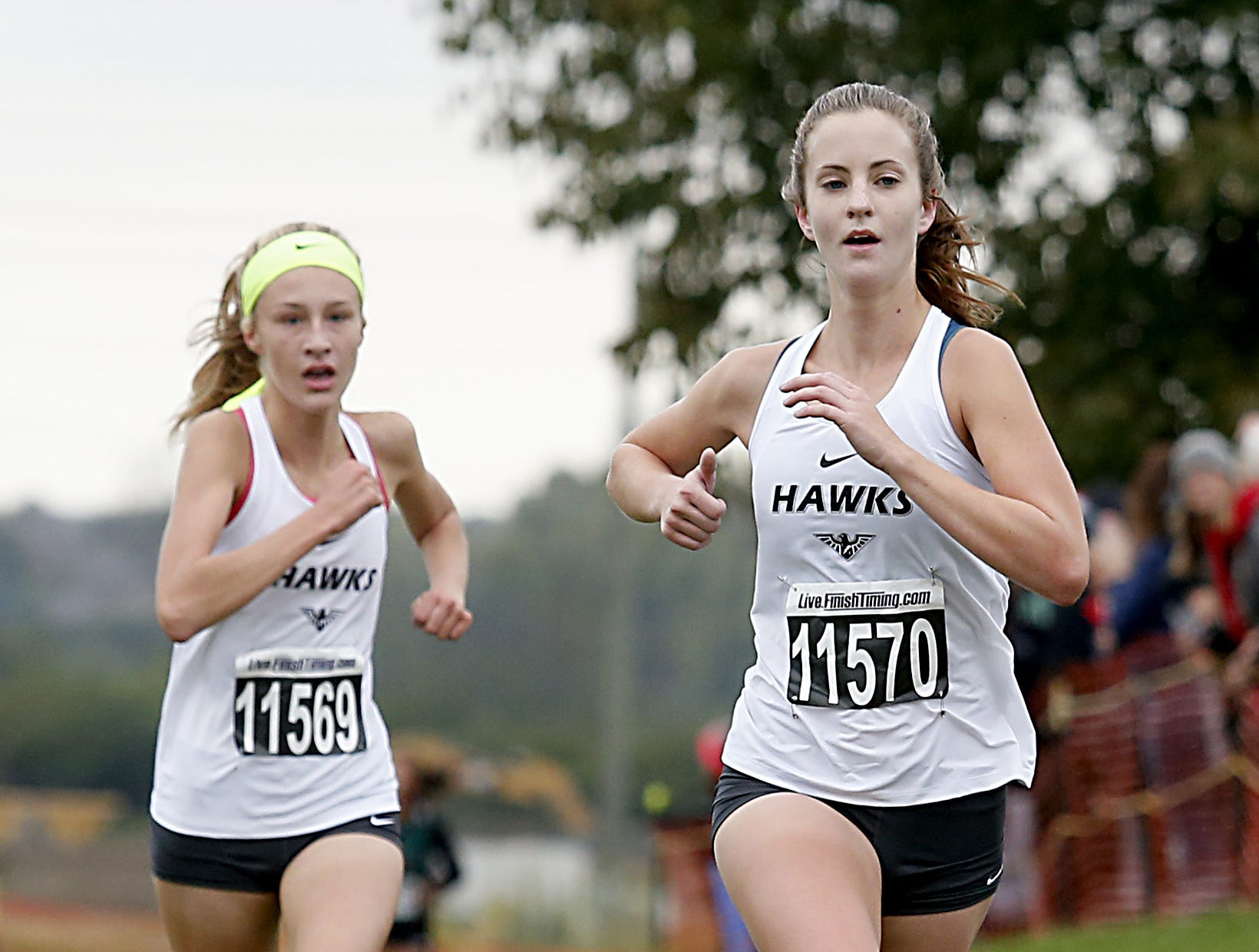 Lakota East's Danielle Horter and Kelsi Harris finish second and third during the Greater Miami Conference Girls and Boys Cross Country Championships at Voice of America Park in West Chester Saturday, Oct. 13, 2018.