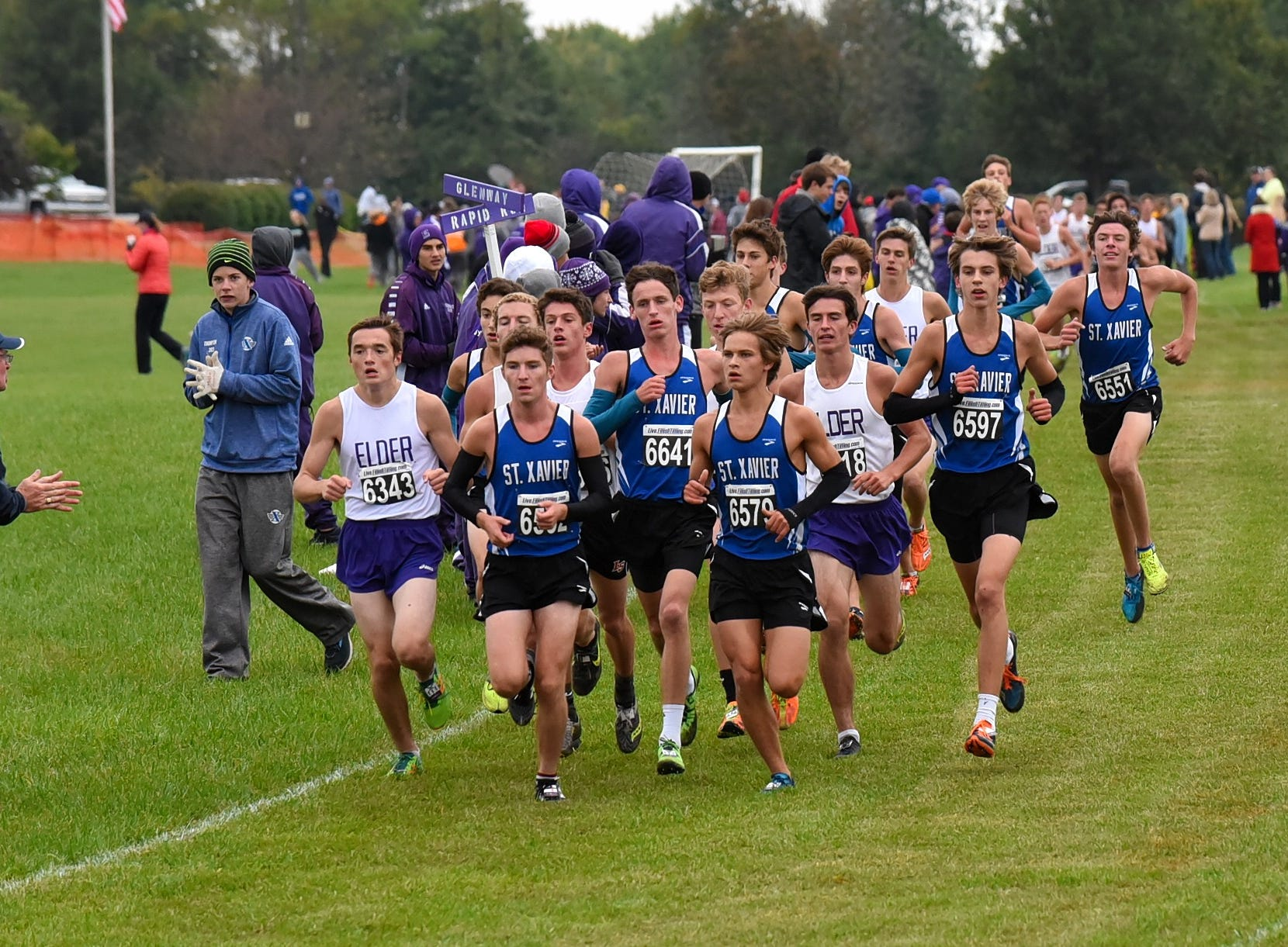 Runners from St. Xavier and Elder lead the GCL pack heading out of the backstretch at the 2018 GCL/GGCL Cross Country Championships, October 13, 2018.