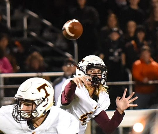 Turpin quarterback Justin Silverstein eyes a completed pass for the Spartans, October 12, 2018.