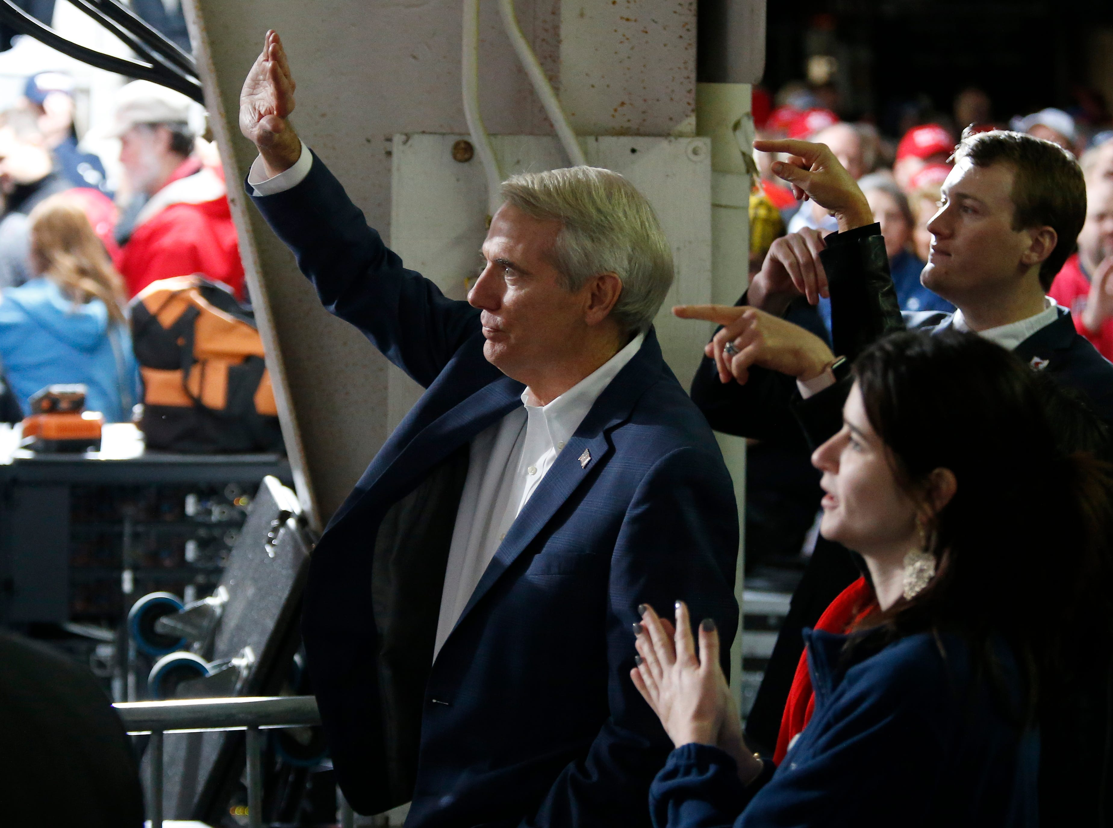 Ohio Senator Rob Portman waves as President Donald Trump points his way during a Make America Great Again rally at the warren County Fair Grounds in Lebanon, Ohio, on Friday, Oct. 12, 2018.
