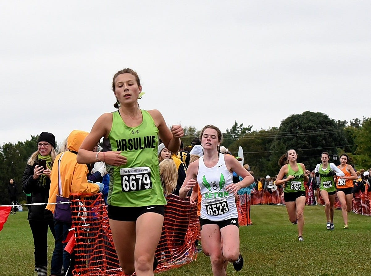 Ursuline's Paige Murdock lead the 10th through 14th place runners to the finish line at the 2018 GCL/GGCL Cross Country Championships, October 13, 2018.