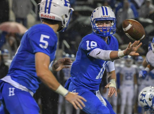 Highlands quarterback Grady Cramer (18) pitches the ball against Covington Catholic, Highlands High School, Ft. Thomas, KY, Friday, October 12, 2018