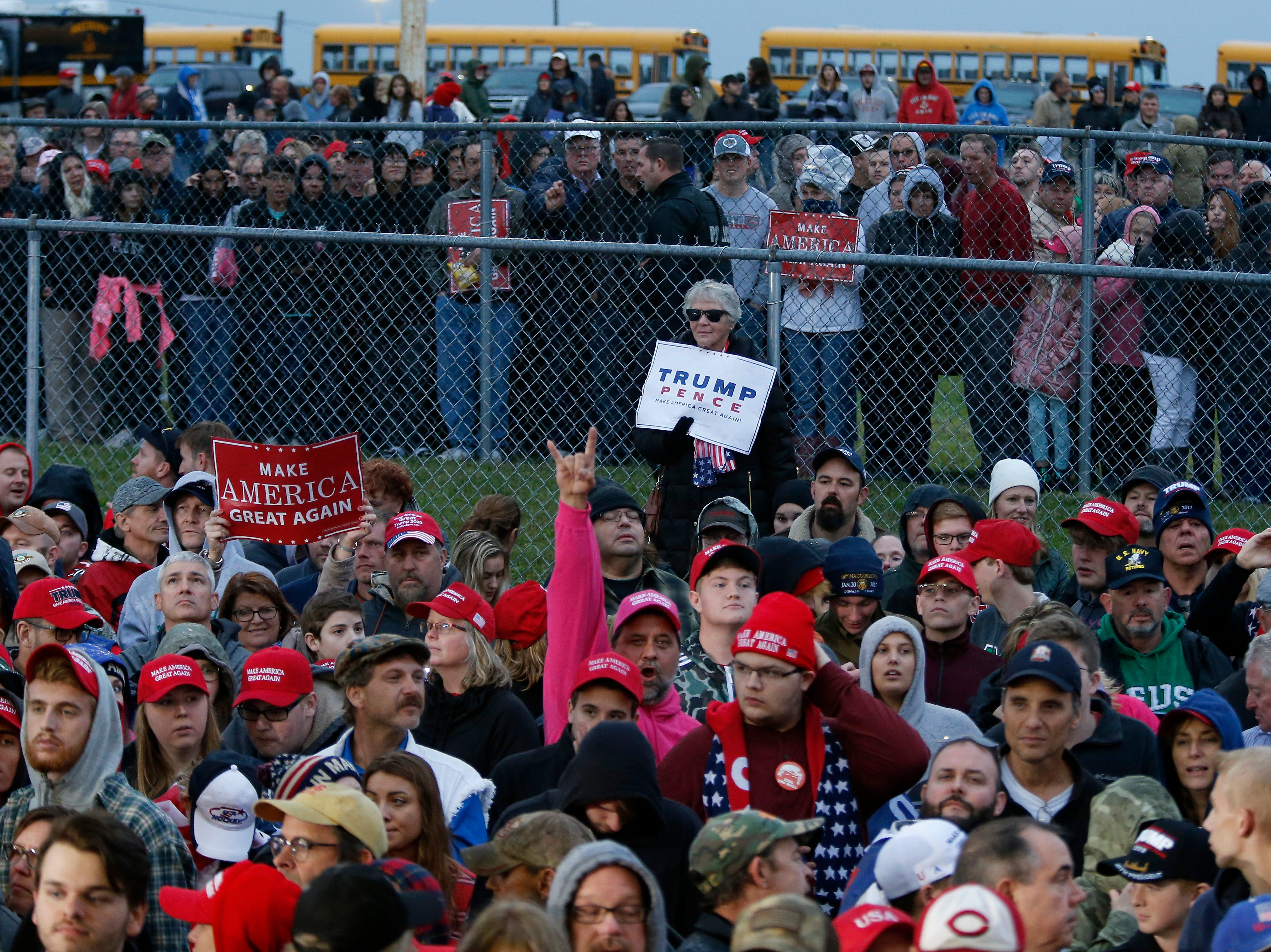 Supports gather outside the shelter as they wait for the arrival of President Donald Trump during a Make America Great Again rally at the warren County Fair Grounds in Lebanon, Ohio, on Friday, Oct. 12, 2018.