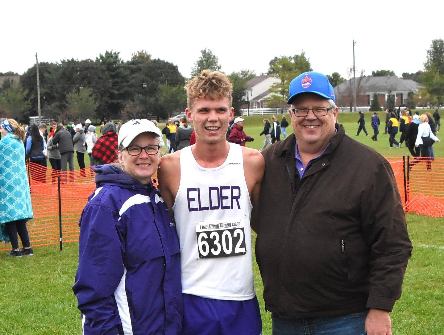 Together with his parents, Jack Dowling celebrates his strong run at the 2018 GCL/GGCL Cross Country Championships, October 13, 2018.