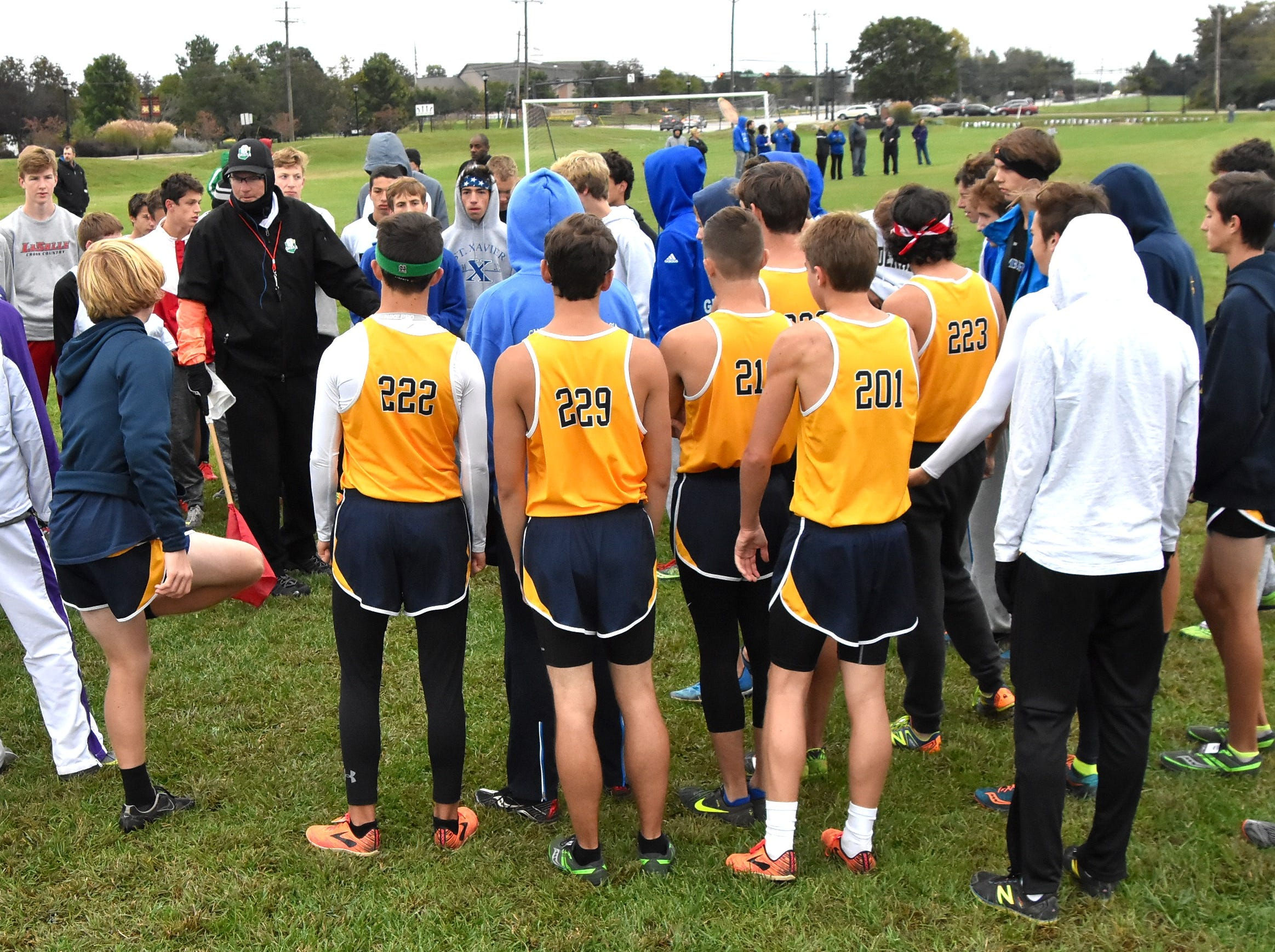 GCL runners get their instruction from an OHSAA official before racing at the 2018 GCL/GGCL Cross Country Championships, October 13, 2018.