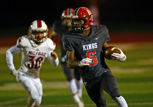 Kings RB Nak'emon Williams runs for a big gain in the game between the Milford Eagles and the Kings Knights at Kings High School.