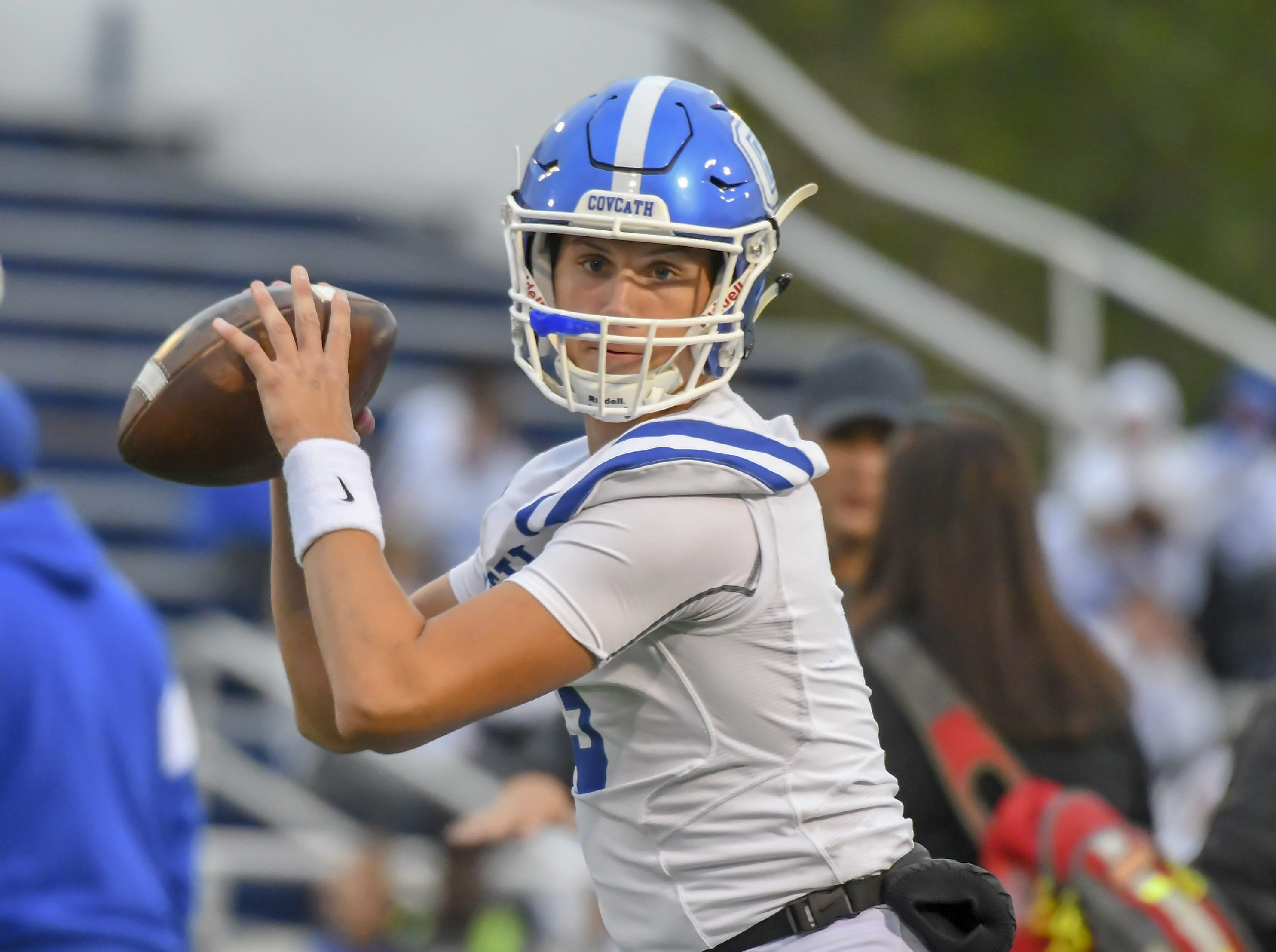 Covington Catholic quarterback Caleb Jacob warms up before their game against the Bluebirds, Highlands High School, Friday, October 12, 2018