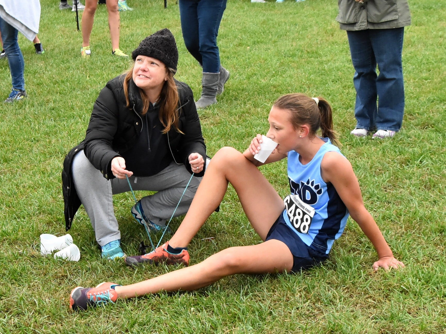 Mt. Notre Dame's Elle Seeger grabs a cold cup of water after finishing 6th at the 2018 GCL/GGCL Cross Country Championships, October 13, 2018.