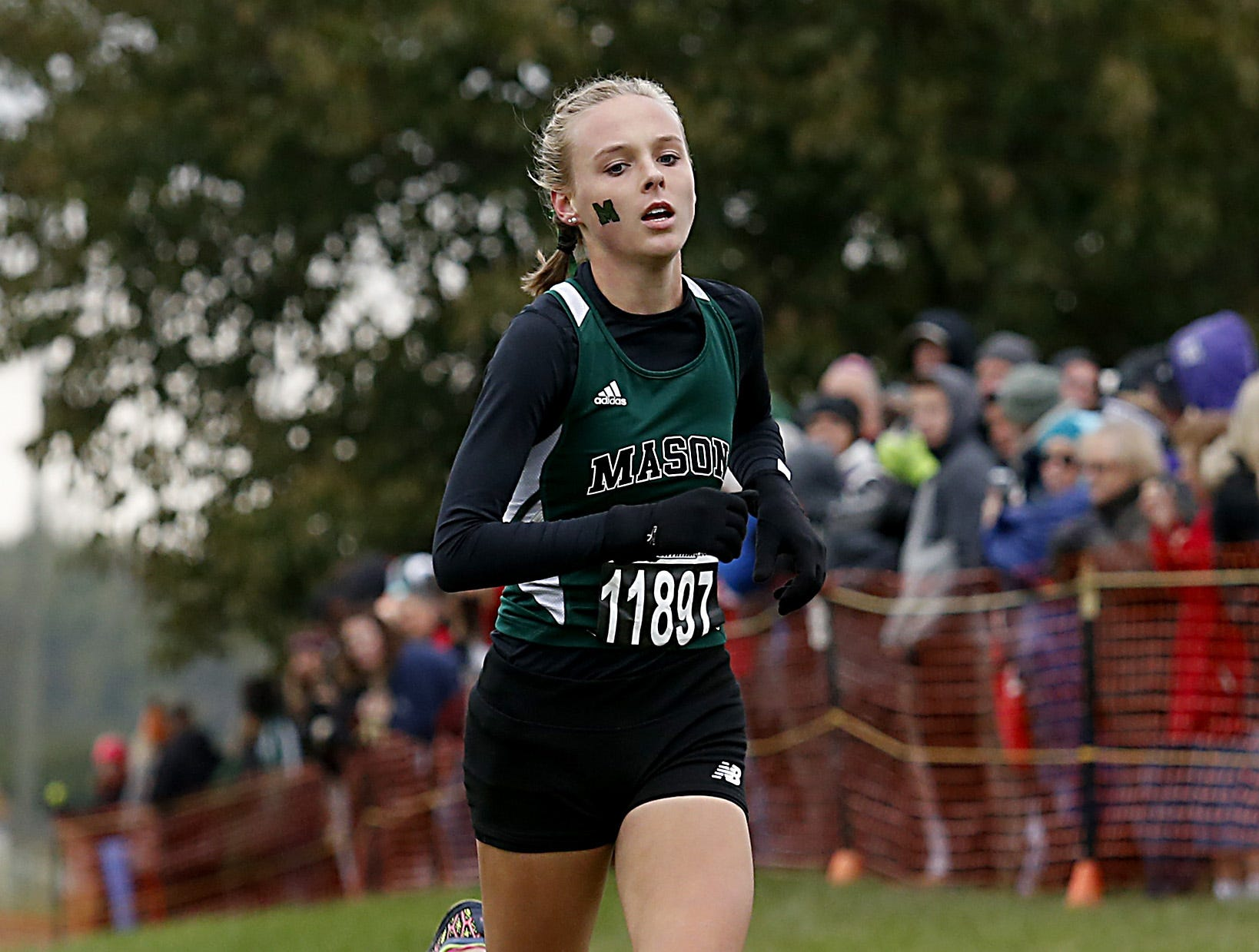 Mason's Maddie Ullom is the first to finish during the Greater Miami Conference Girls and Boys Cross Country Championships at Voice of America Park in West Chester Saturday, Oct. 13, 2018.