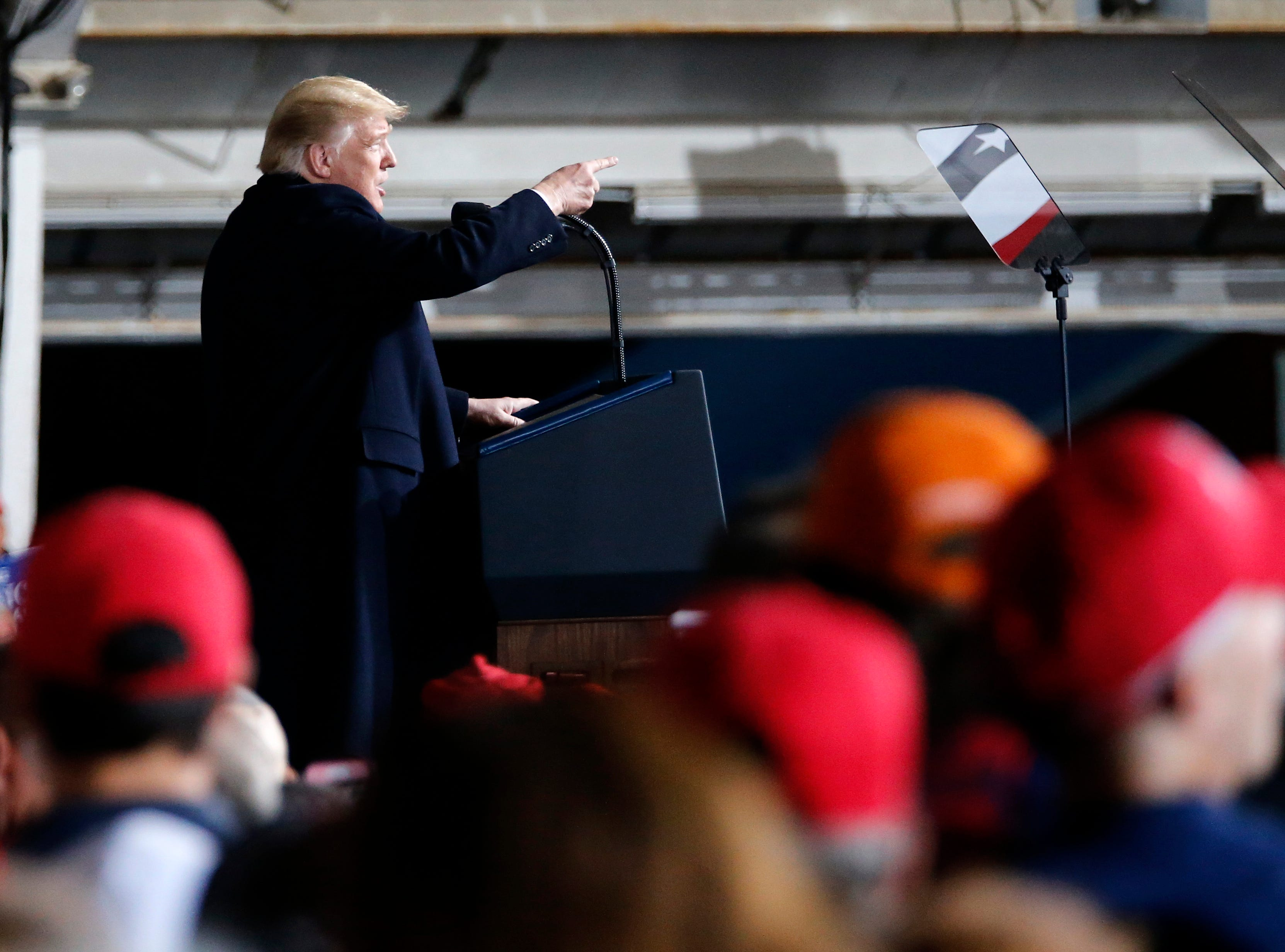 President Donald Trump points toward the press risers in the back of the room during a Make America Great Again rally at the warren County Fair Grounds in Lebanon, Ohio, on Friday, Oct. 12, 2018.