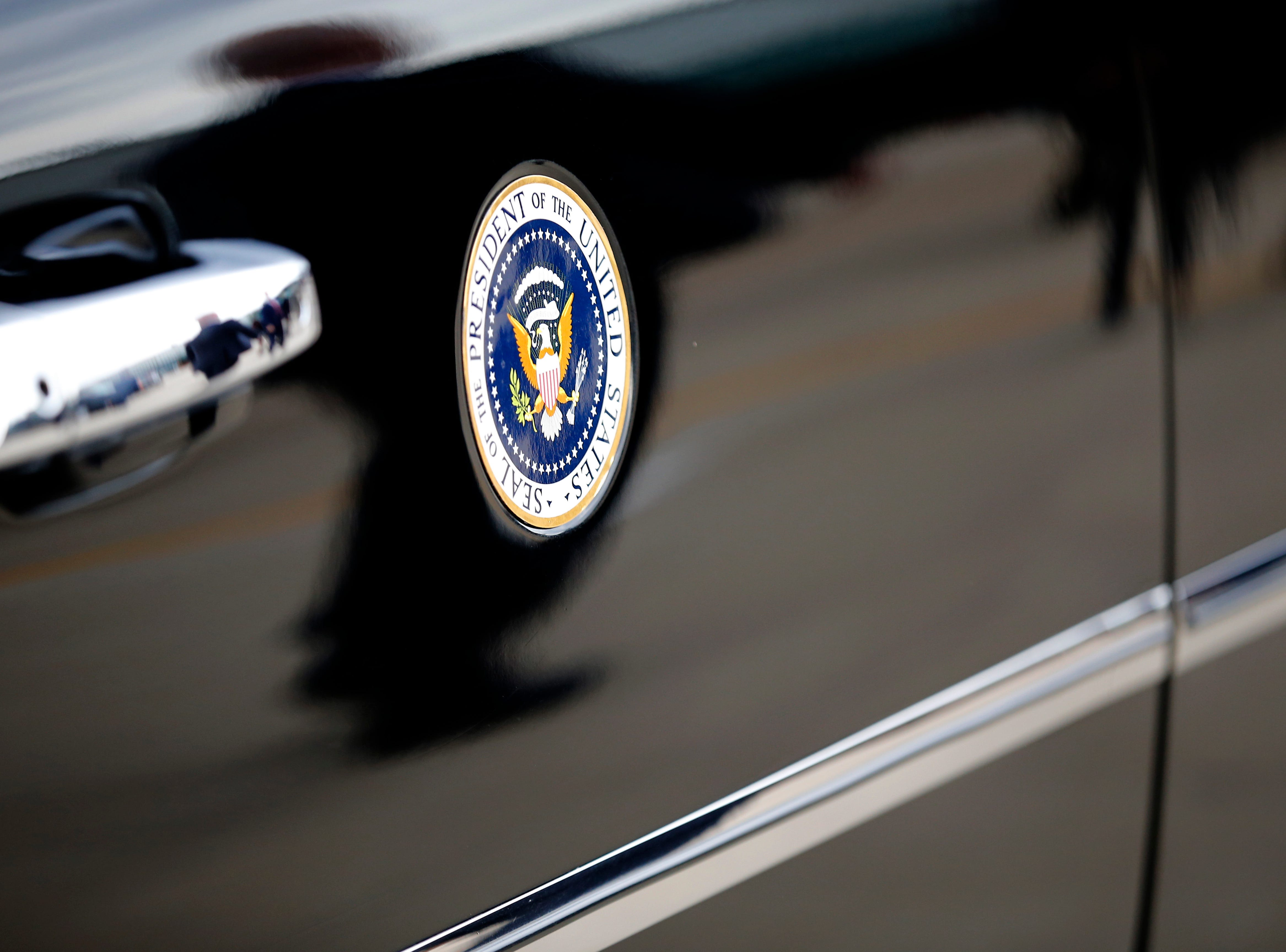 The presidential limousine moves into position alongside President Donald Trump as he talks with a gathering of supporters after landing at Lunken Airport in Cincinnati on Friday, Oct. 12, 2018. President Trump visited the Cincinnati area for a MAGA Rally at the Warren County Fair Grounds in Lebanon, Ohio, Friday night.
