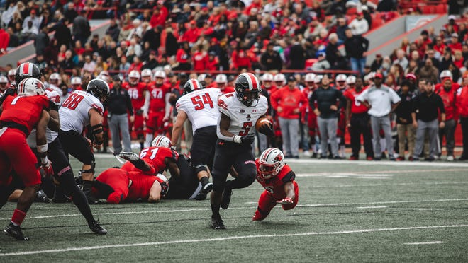 Austin Peay running back Kentel Williams rushes past a Southeast Missouri defender on Saturday at Houck Field.