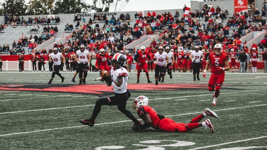 Austin Peay wide receiver DJ Montgomery avoids a Southeast Missouri defender on Saturday at Houck Field in Cape Girardeau, Missouri.