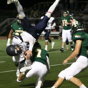 Brearley's Chris Keith gets upended by New Providence's Anthony Sidoli after Keith caught a pass on Friday, Oct. 12, 2018 at New Providence.